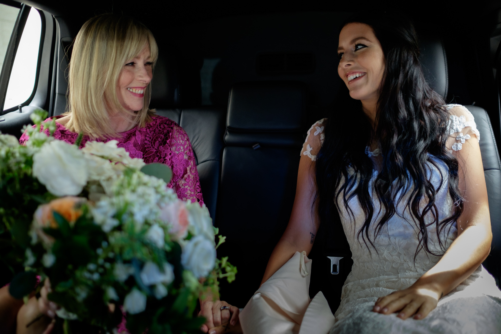 Danni and her mom share a special moment while riding in their limousine on the way to Danni's first look at Osgood Hall.
