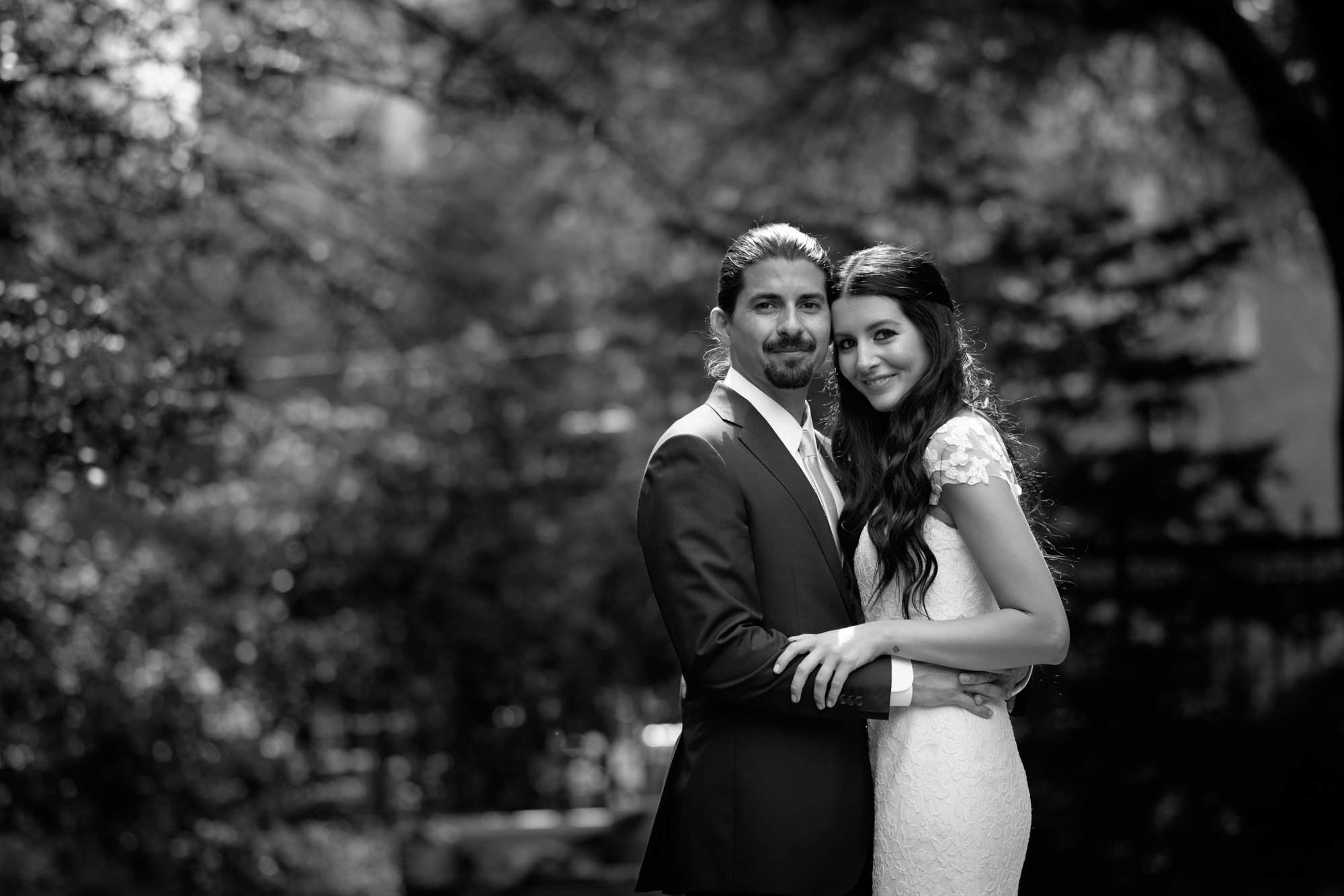 Danni + Felipe pose for a formal wedding portrait at Osgood Hall before their wedding at the Fermenting Cellar in Toronto.