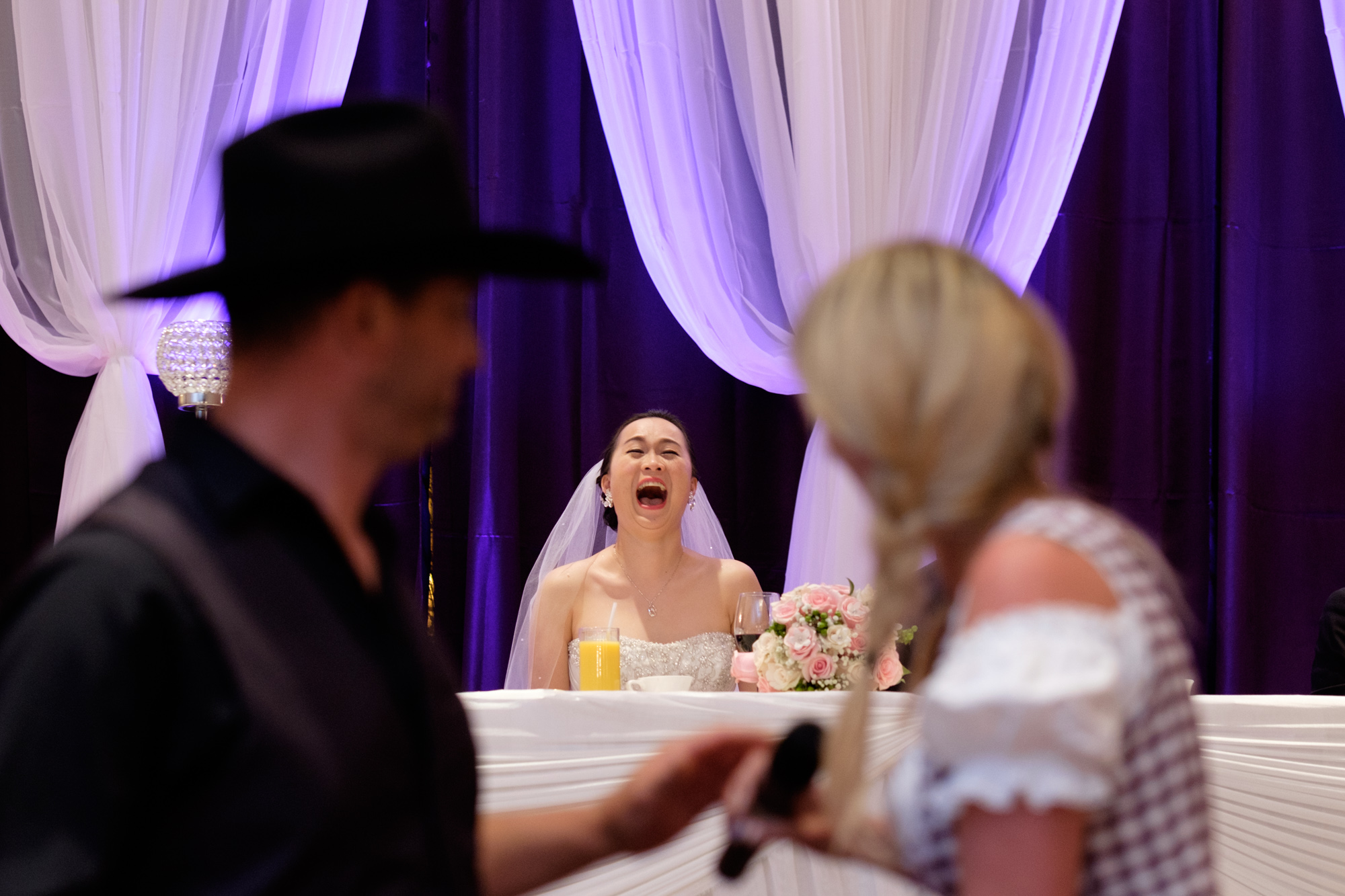 Rene's sisters and brother in toast the bride during Jing + Rene's wedding reception at the Premiere Ballroom.