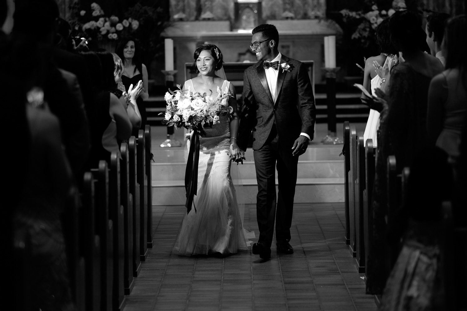 Najwa + Trevin walk down the aisle after their wedding ceremony in Toronto.