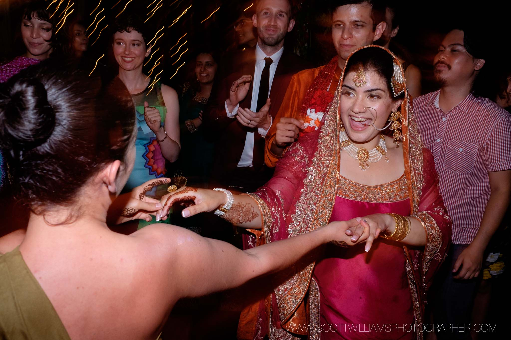 The bride dances with guests during the wedding reception of her backyard wedding in Burlington, Ontario.