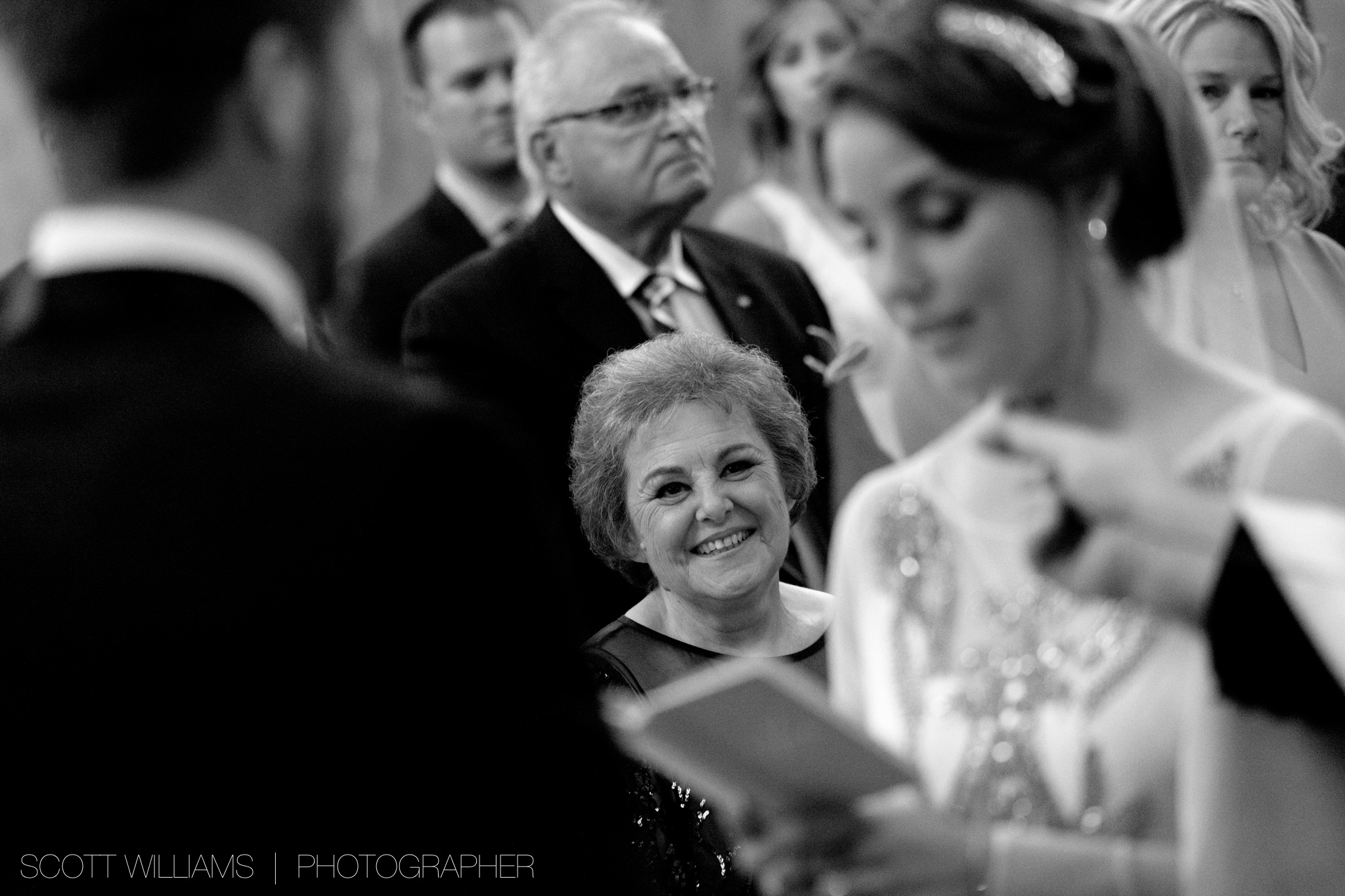 Christina's mother looks on as she and Tim exchange personal wedding vows during their Ukrainian wedding ceremony in Toronto.