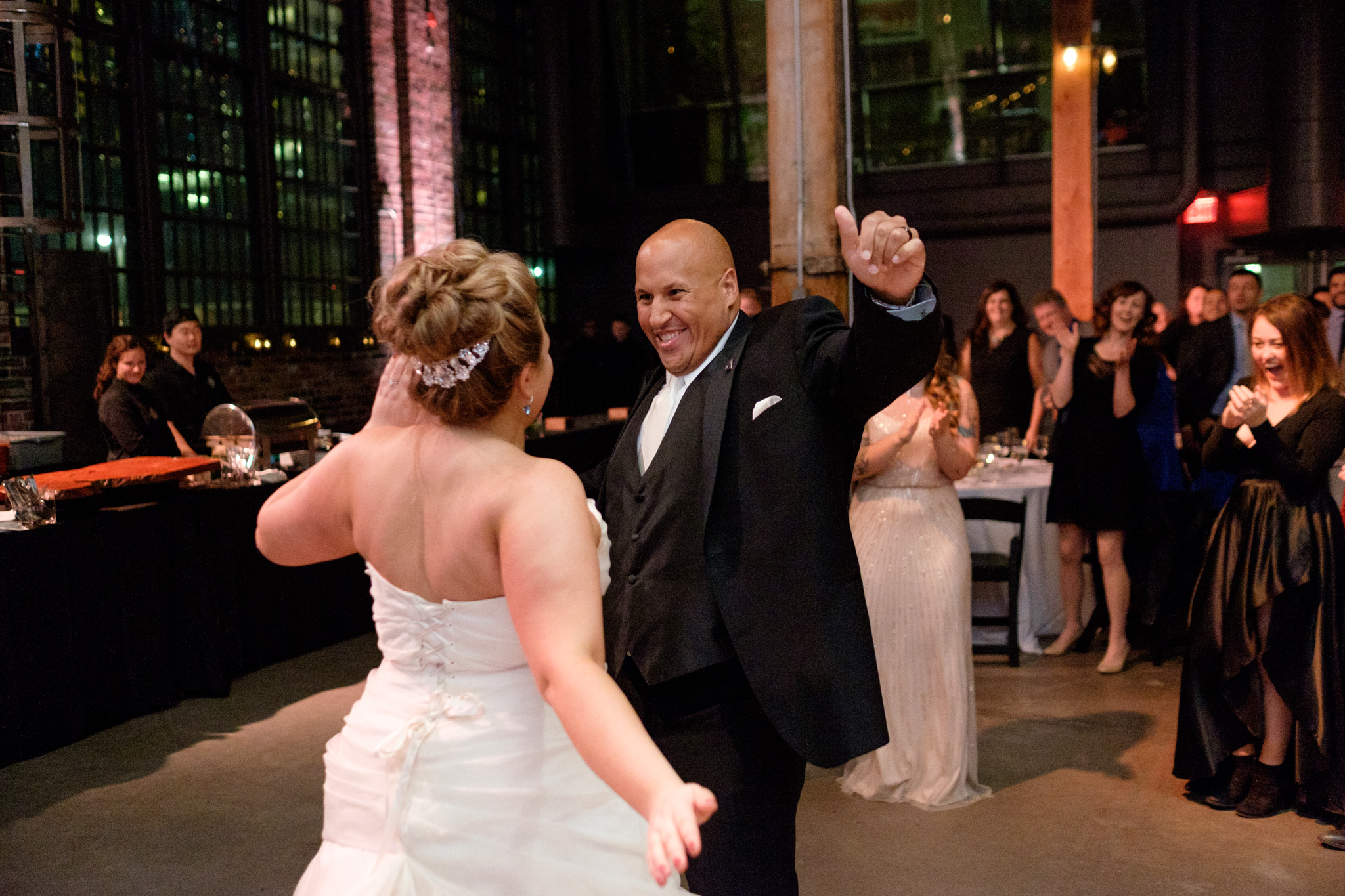 Bernie and Savannah make an entrance during their wedding reception at the Steamwhistle Brewery in Toronto.