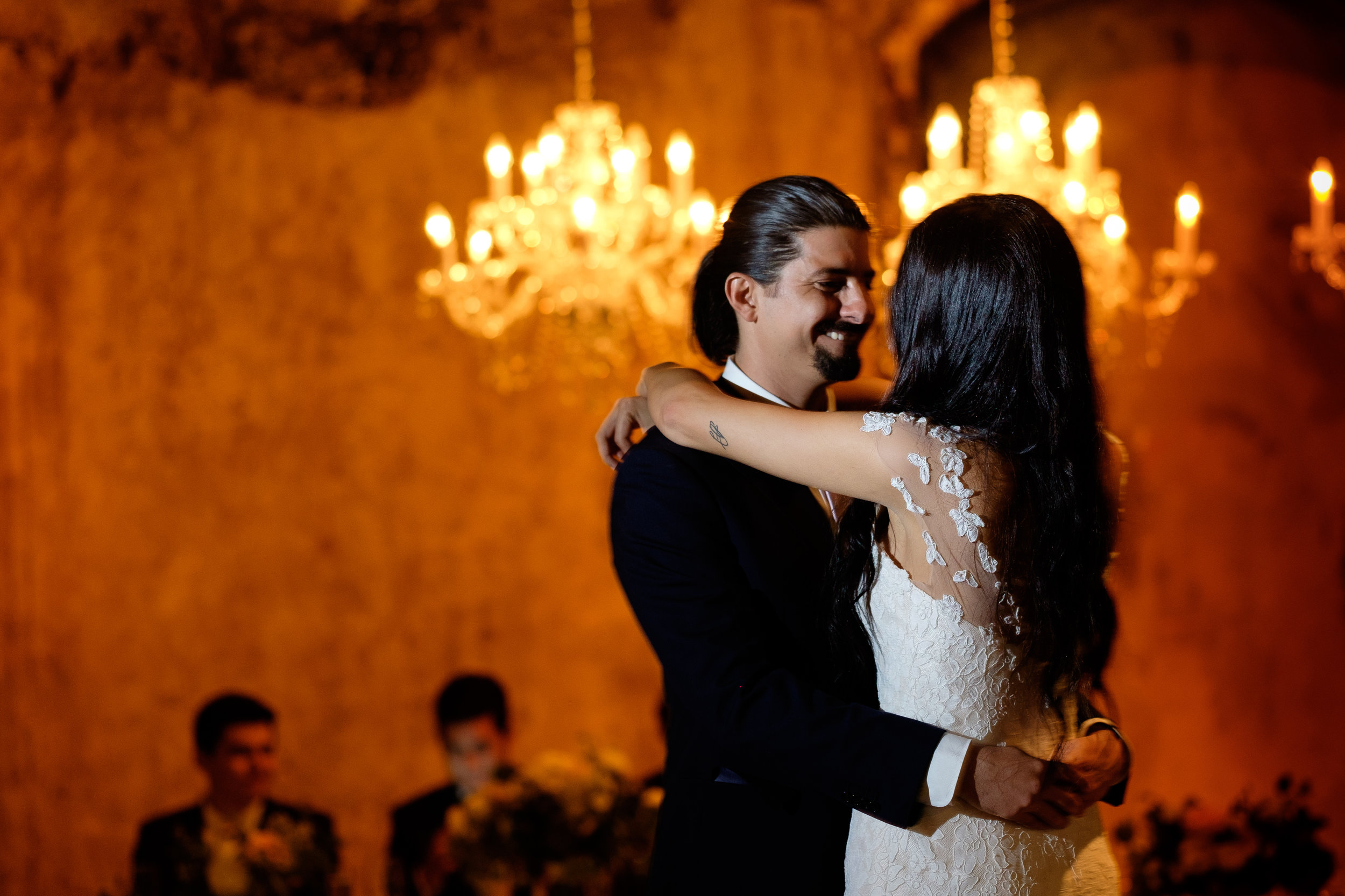 This is one of my favourite first dance images from this year, I love the contrast of the Danielle + Felipe with the warm tones in the background.  Plus, check out his expression.... that's one happy groom!