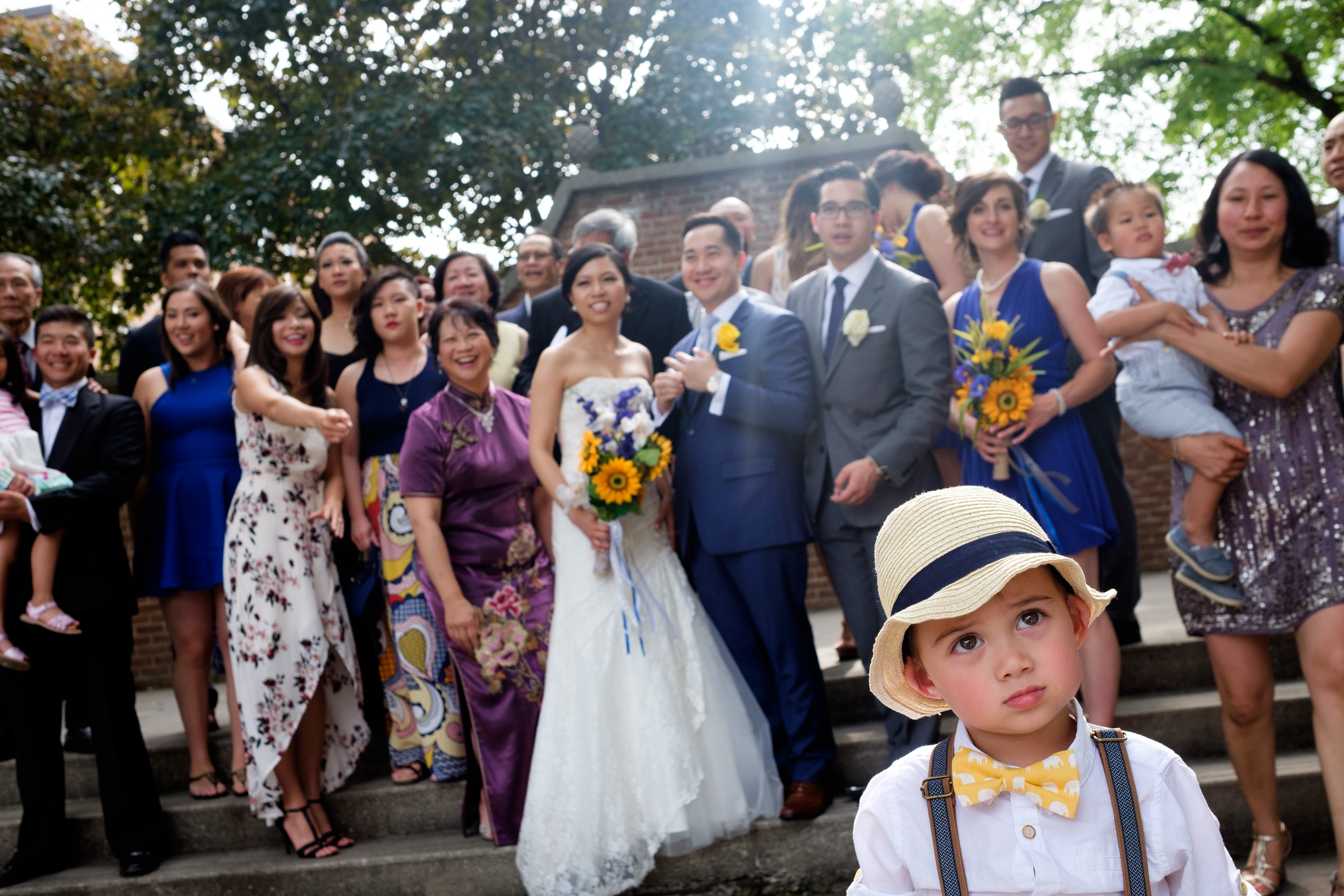 It's better to be lucky than good!   (it also helps being good).  Sometimes when you have an uncooperative ring bearer you turn lemons into lemonade.  As we were trying to get a big extended family picture the groom's nephew decided he was going to do his own thing.