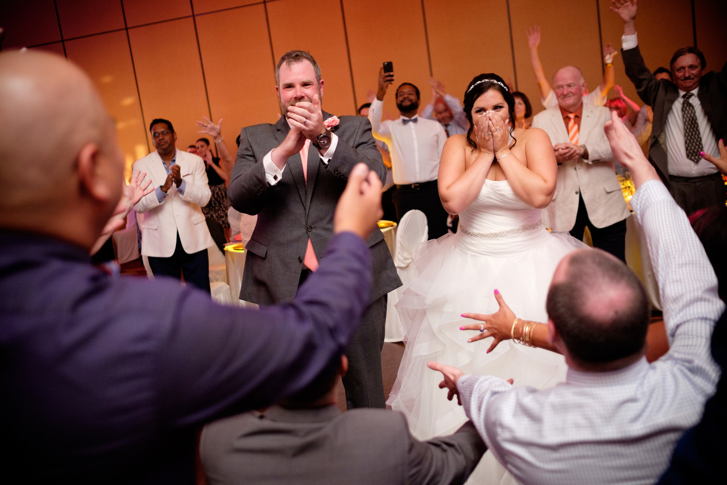 The bride and groom are surprised with a flash mob from their wedding guests during their Toronto wedding reception.