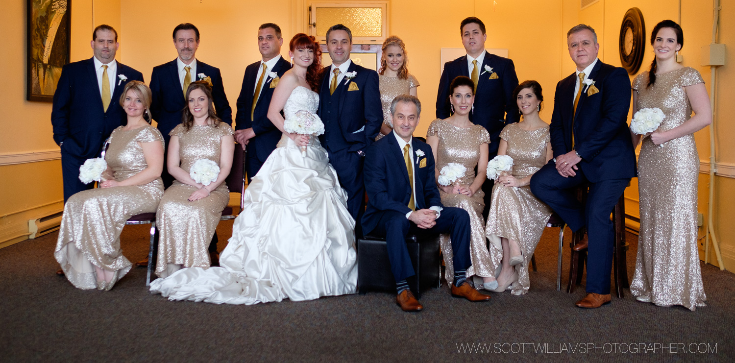 The bridal party poses for a formal portrait at the Capitol Theatre in North Bay, Ontario