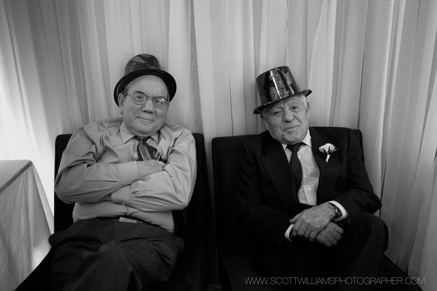 Two guys enjoying a quiet corner during the wedding reception in North Bay, Ontario.