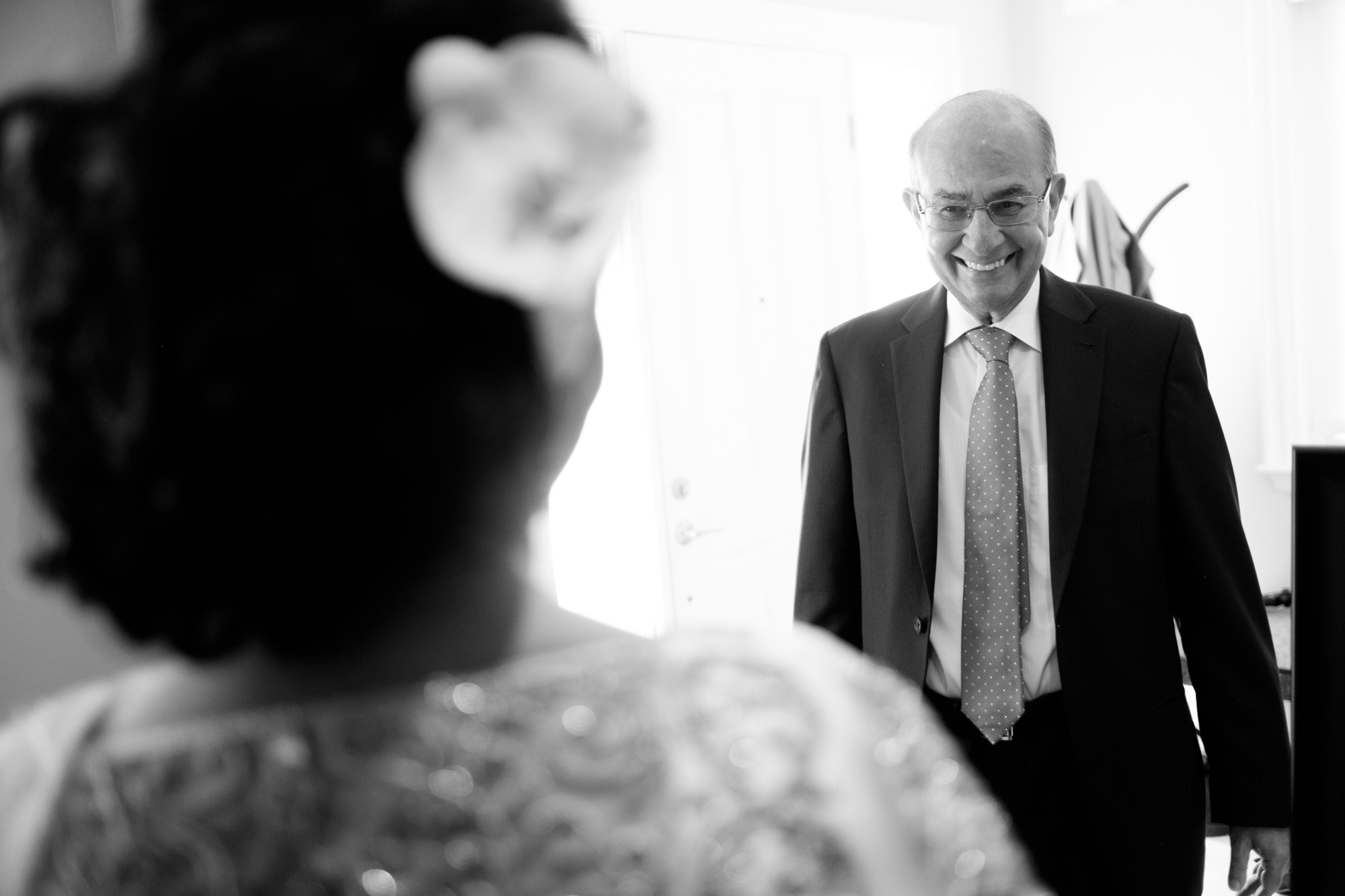 The bride Noor's father smiles as he sees his daughter for the first time before their wedding ceremony at the Toronto Reference Library.