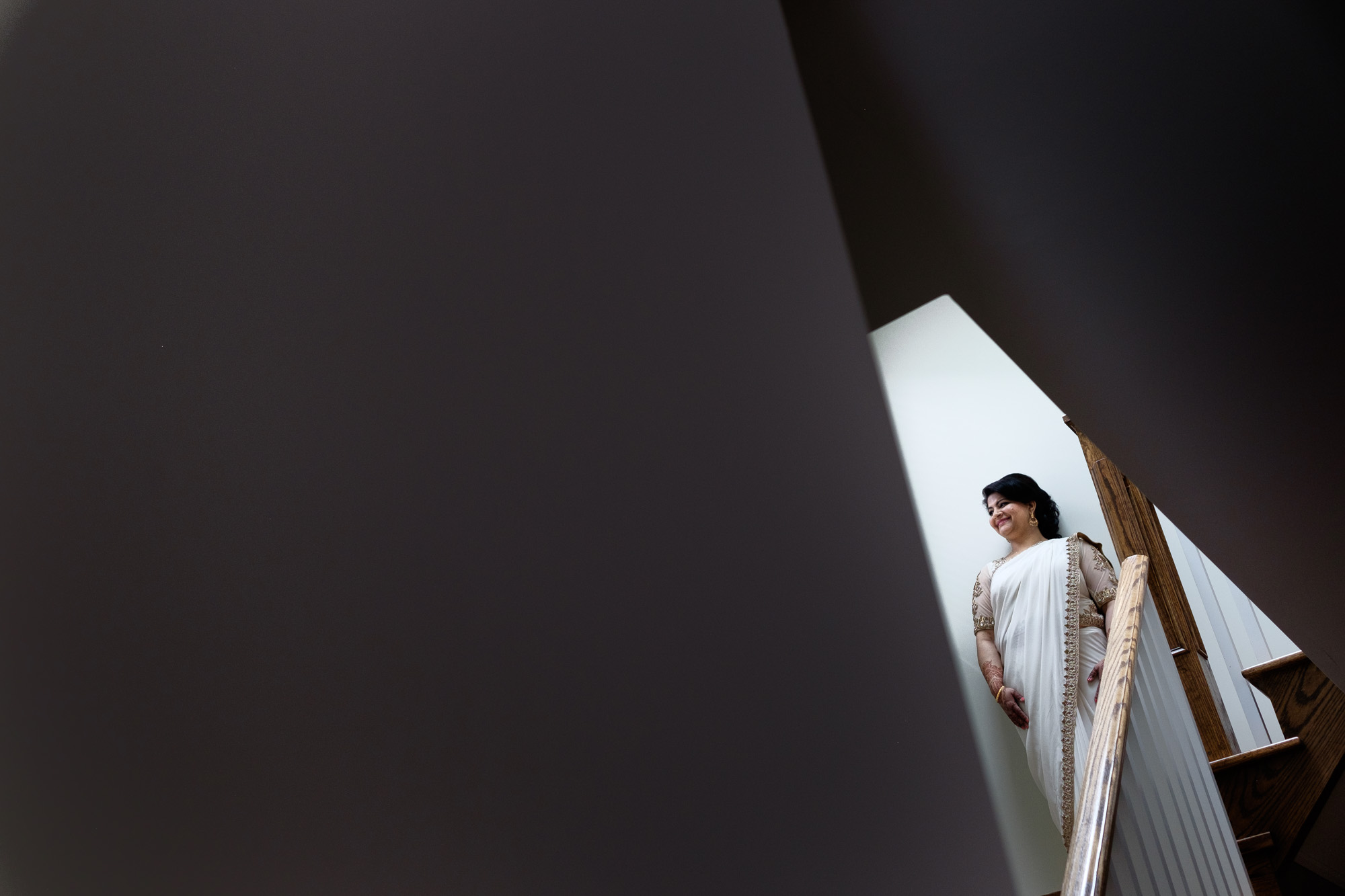 Noor poses for a bridal portait in her families home before her wedding at the Toronto Reference Library.