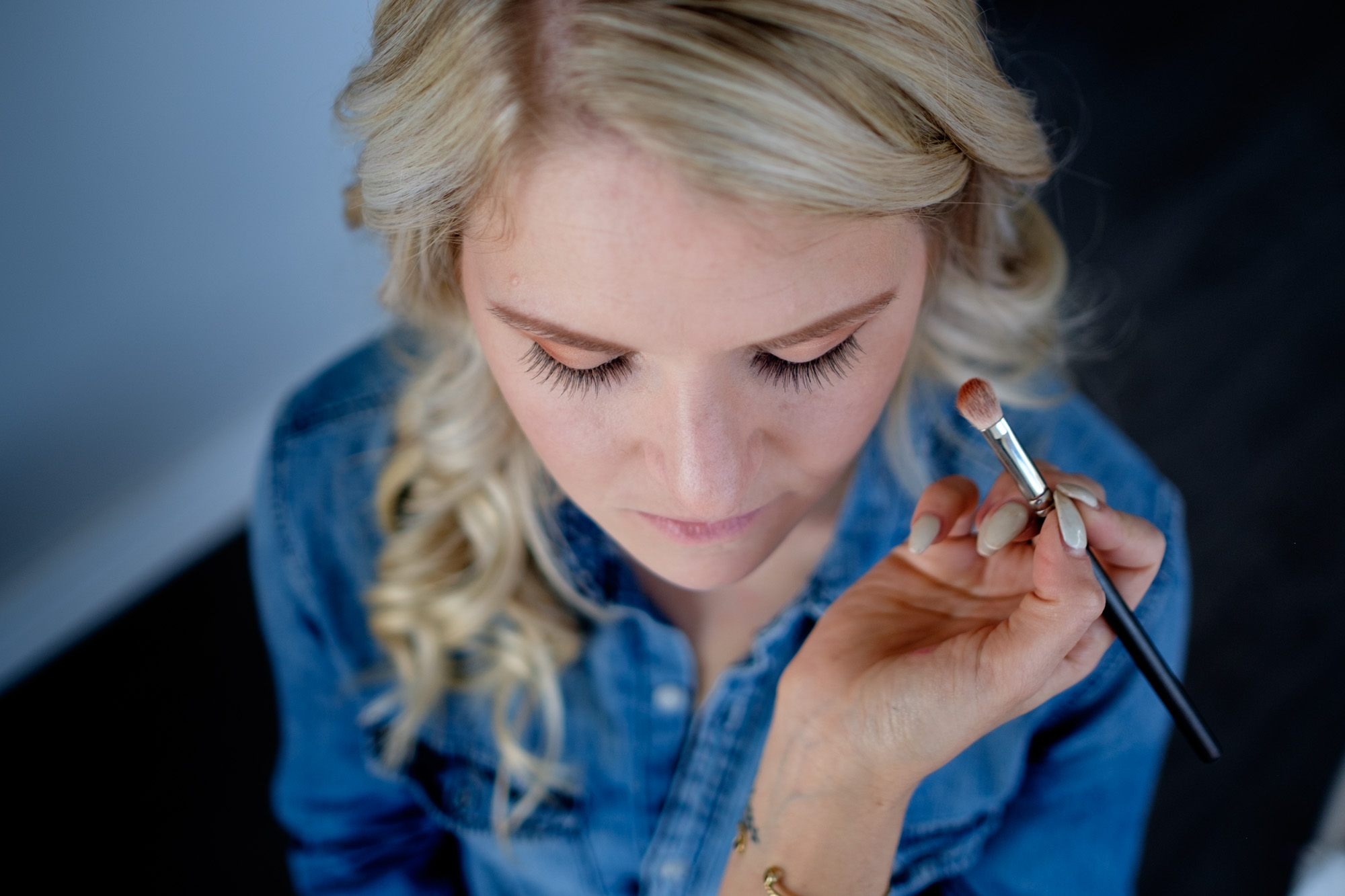 The bride has her make up applied before her wedding at Whistle Bear in Cambridge, Ontario.