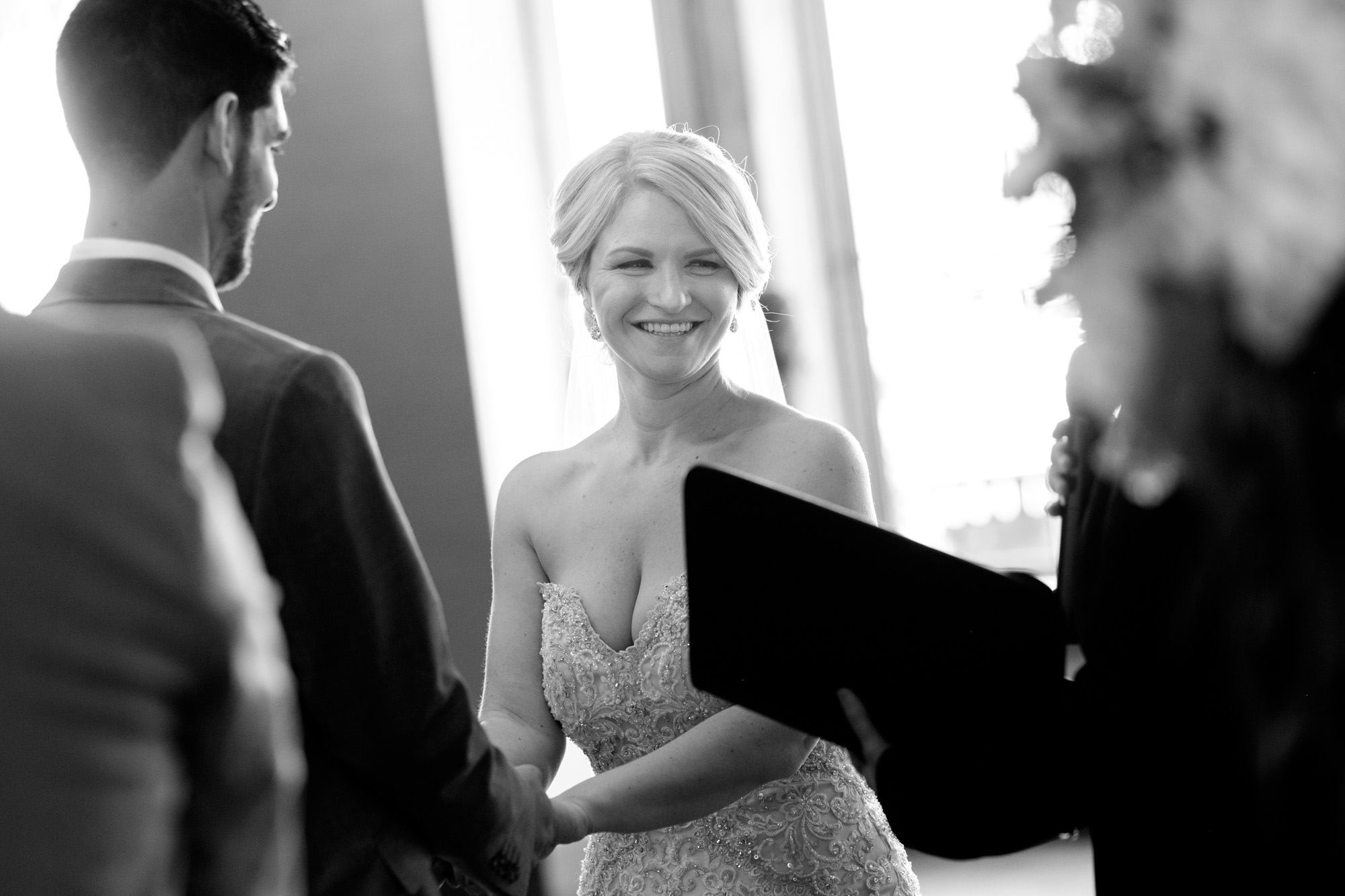 The bride laughs during her wedding ceremony at Whistle Bear in Cambridge, Ontario.