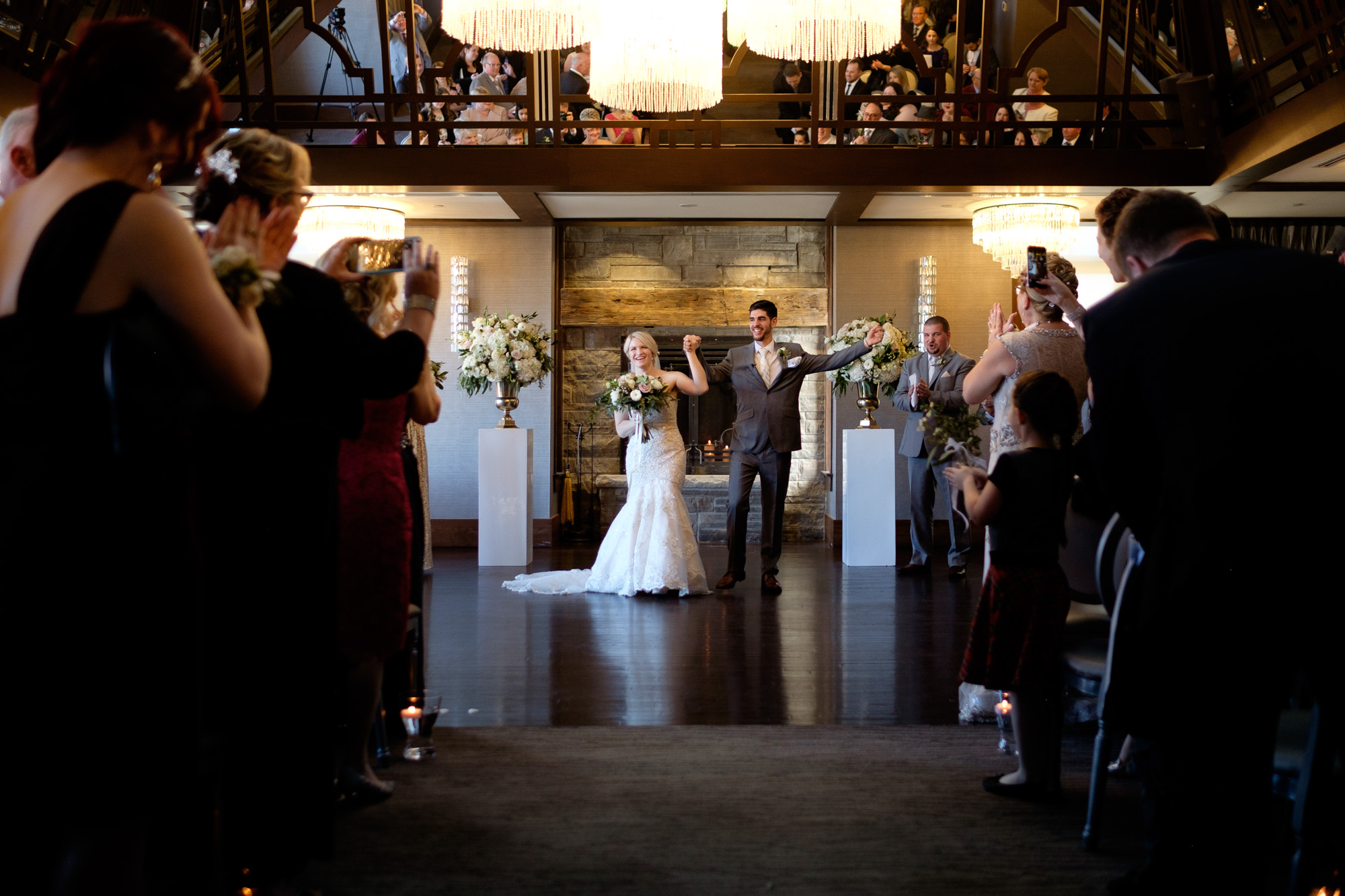 Sarah and Rob celebrate with their guests after their wedding ceremony at Whistle Bear in Cambridge, Ontario.