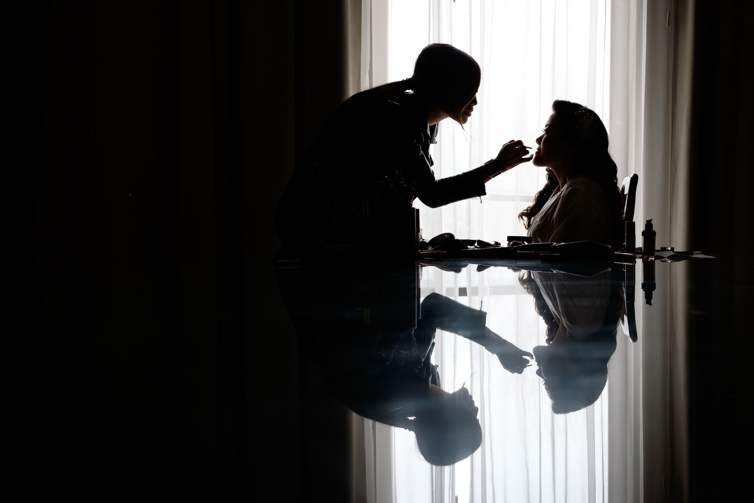 Helen has her makeup applied in the suite at the Delta Hotel before their wedding at the Guild Inn Estate in Toronto.
