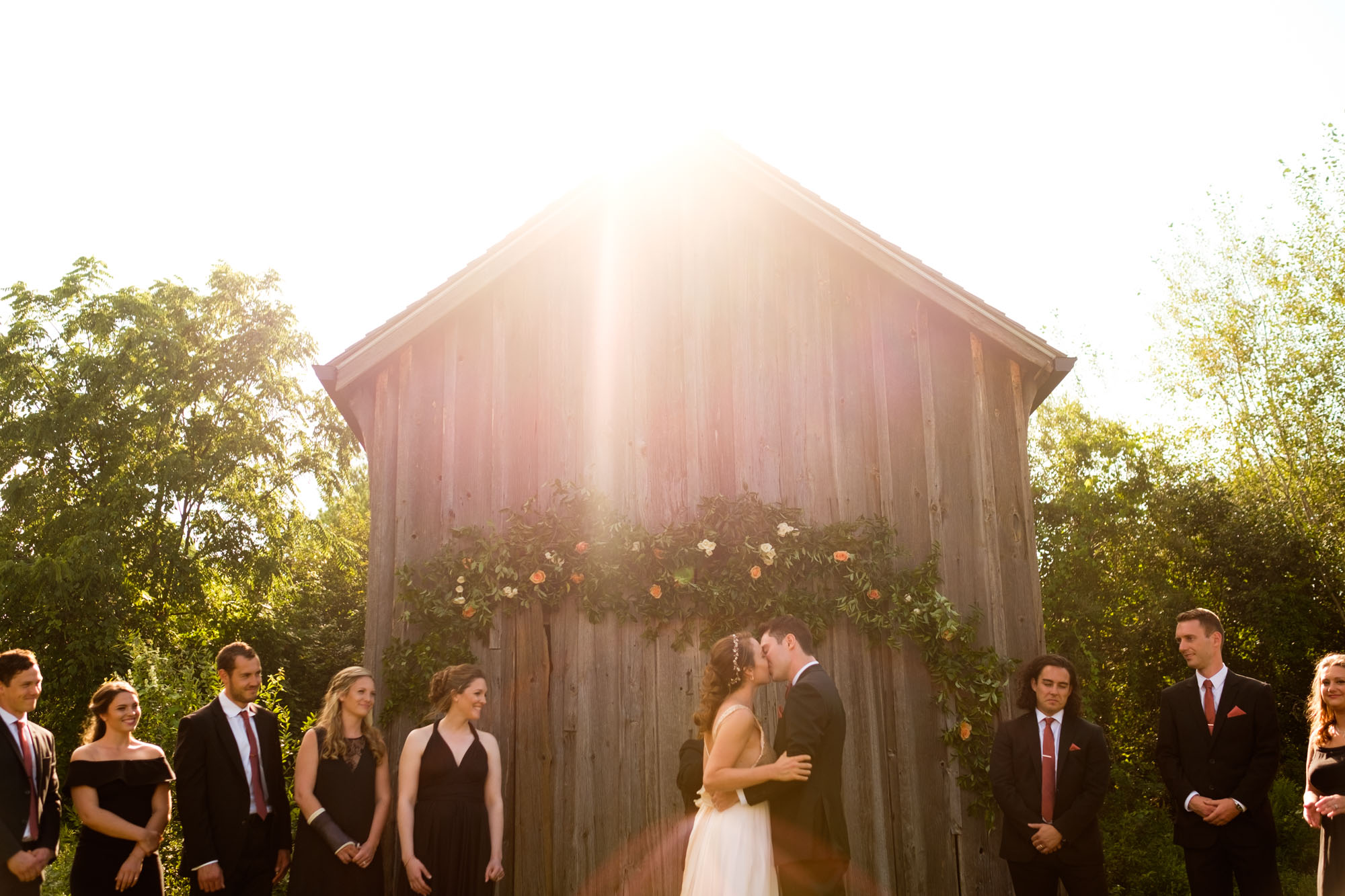 Jennifer and Andrew kiss during the outdoor wedding ceremony at the Markham Museum