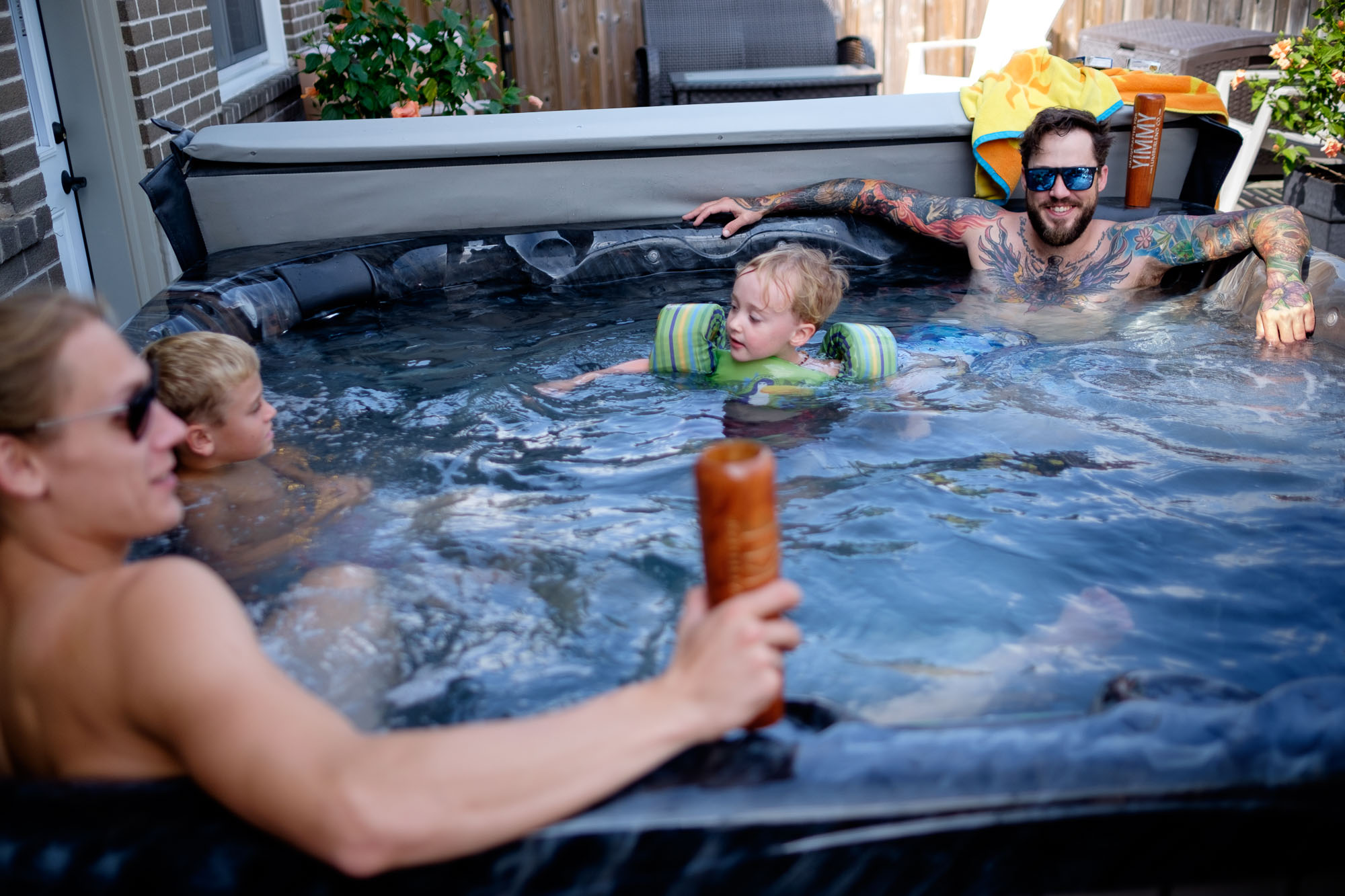 The groom relaxes in a hot tub before his backyard wedding in Ontario, Canada.