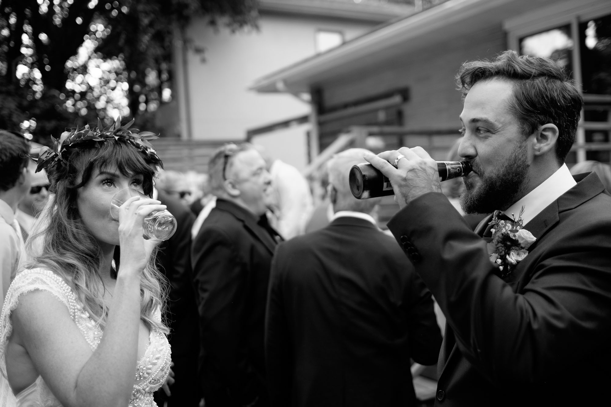 Kristin & Adam share a drink right after their outdoor wedding ceremony during their backyard wedding in Barrie, Ontario.  Photograph by Scott Williams.