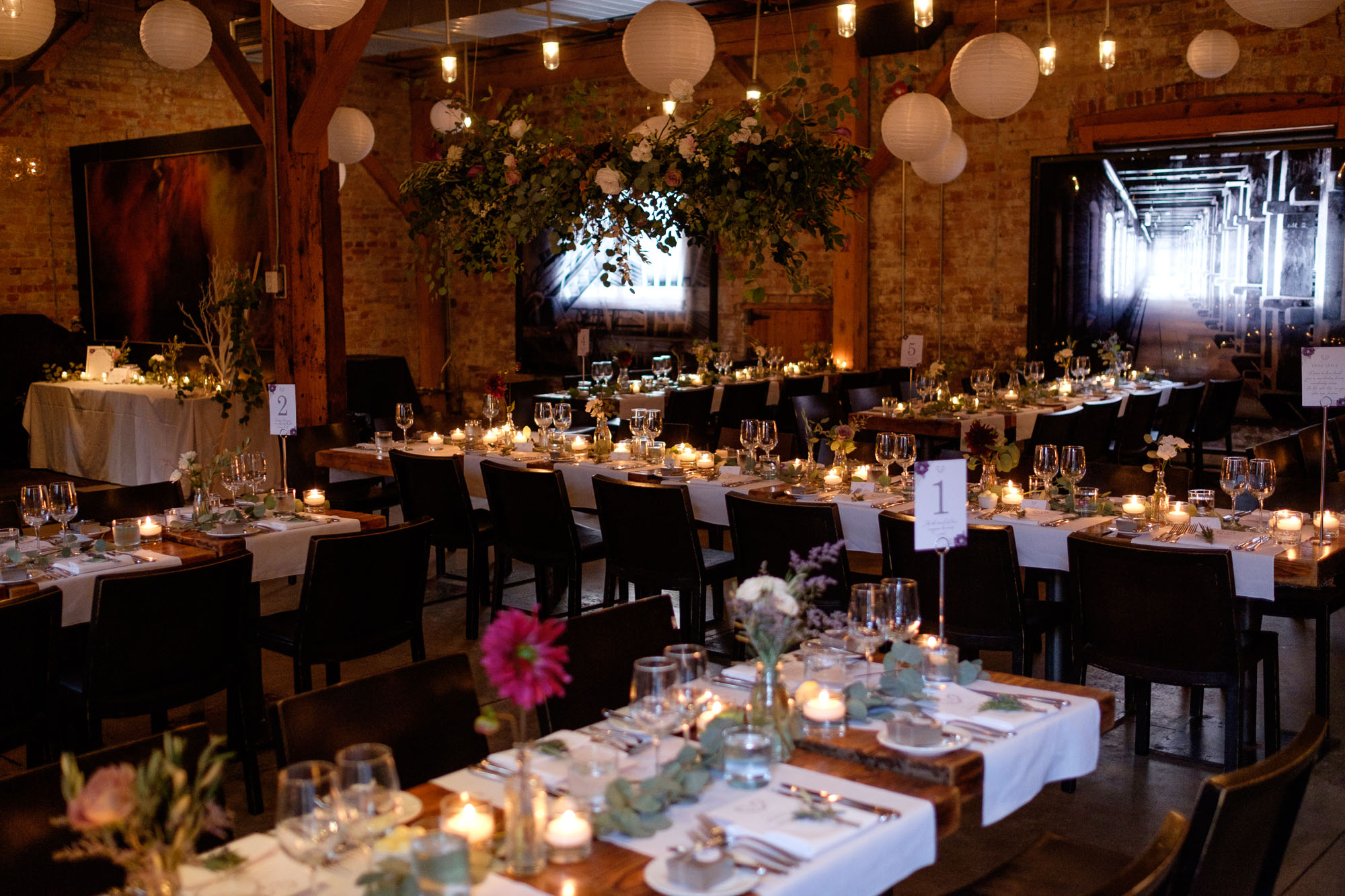 The wedding reception room set up at Archeo in the Distillery District for Cindy + Enrico's wedding.