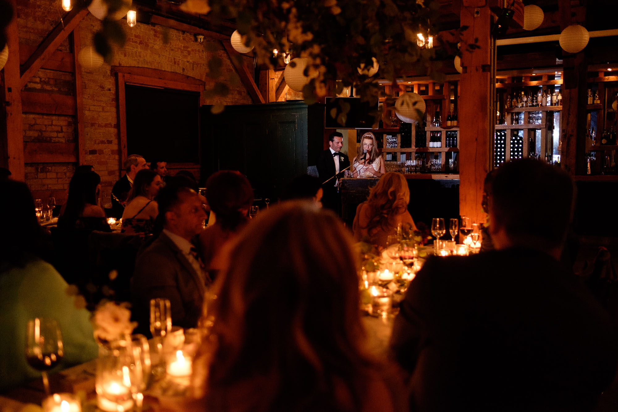 Cindy + Enrico toasts their guests during their wedding reception at the Archeo restaurant in Toronto.