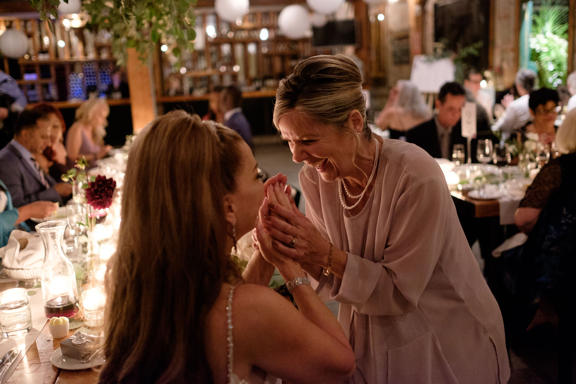 Cindy and one of her guests share a laugh during their wedding reception at Archeo in the Distillery District.