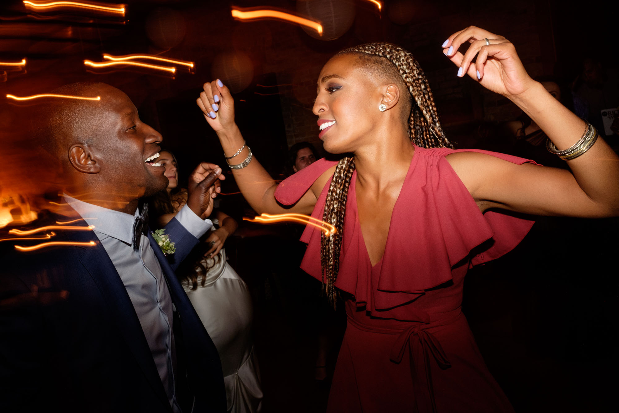 Guests dance the night away during the wedding reception at Archeo.