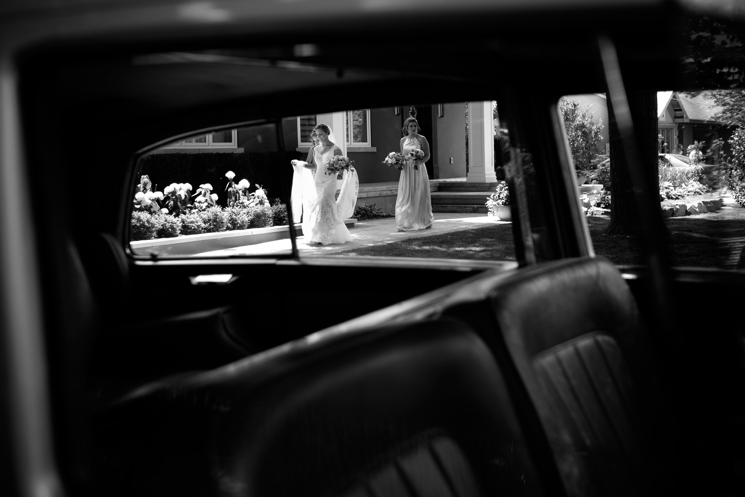 Sabrina leaves her parents house to ride in a classic Rolls Royce before her wedding ceremony.