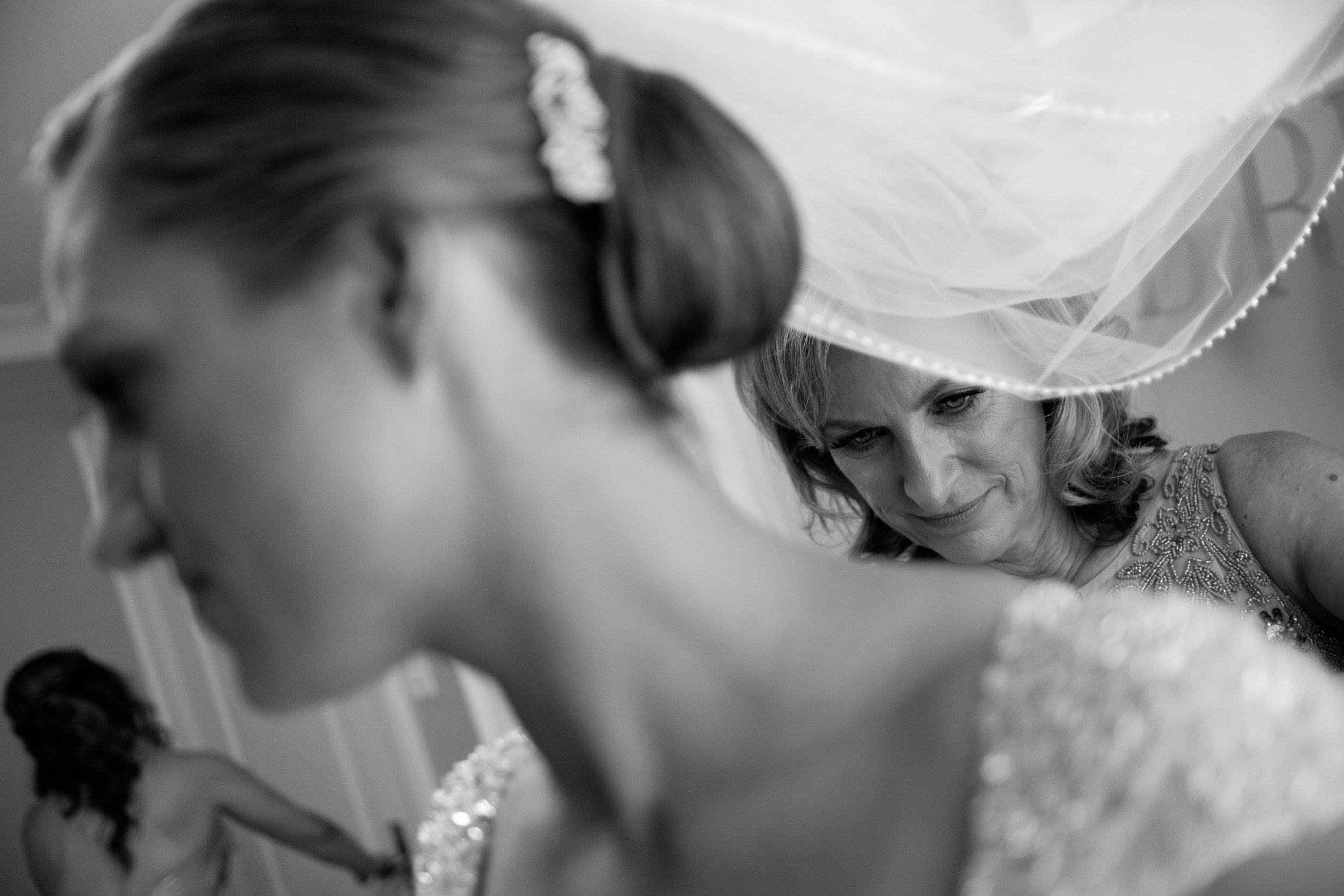 Sabrina's mom helps her get dressed before their wedding in Toronto.