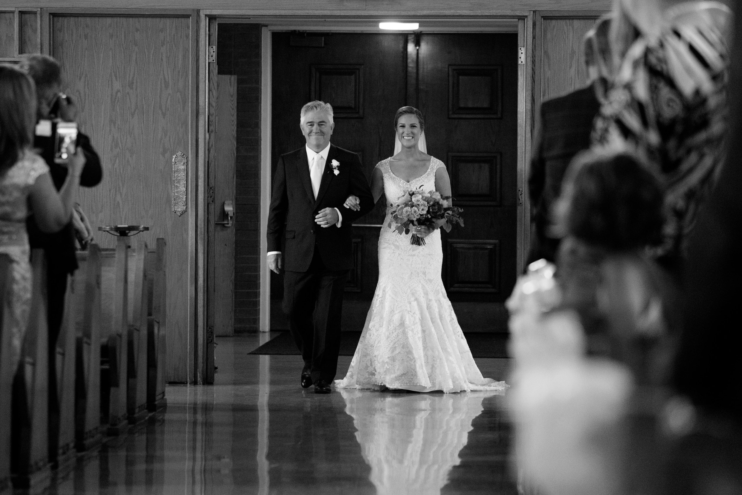 Sabrina and her dad walk down the aisle during her wedding ceremony in Toronto.