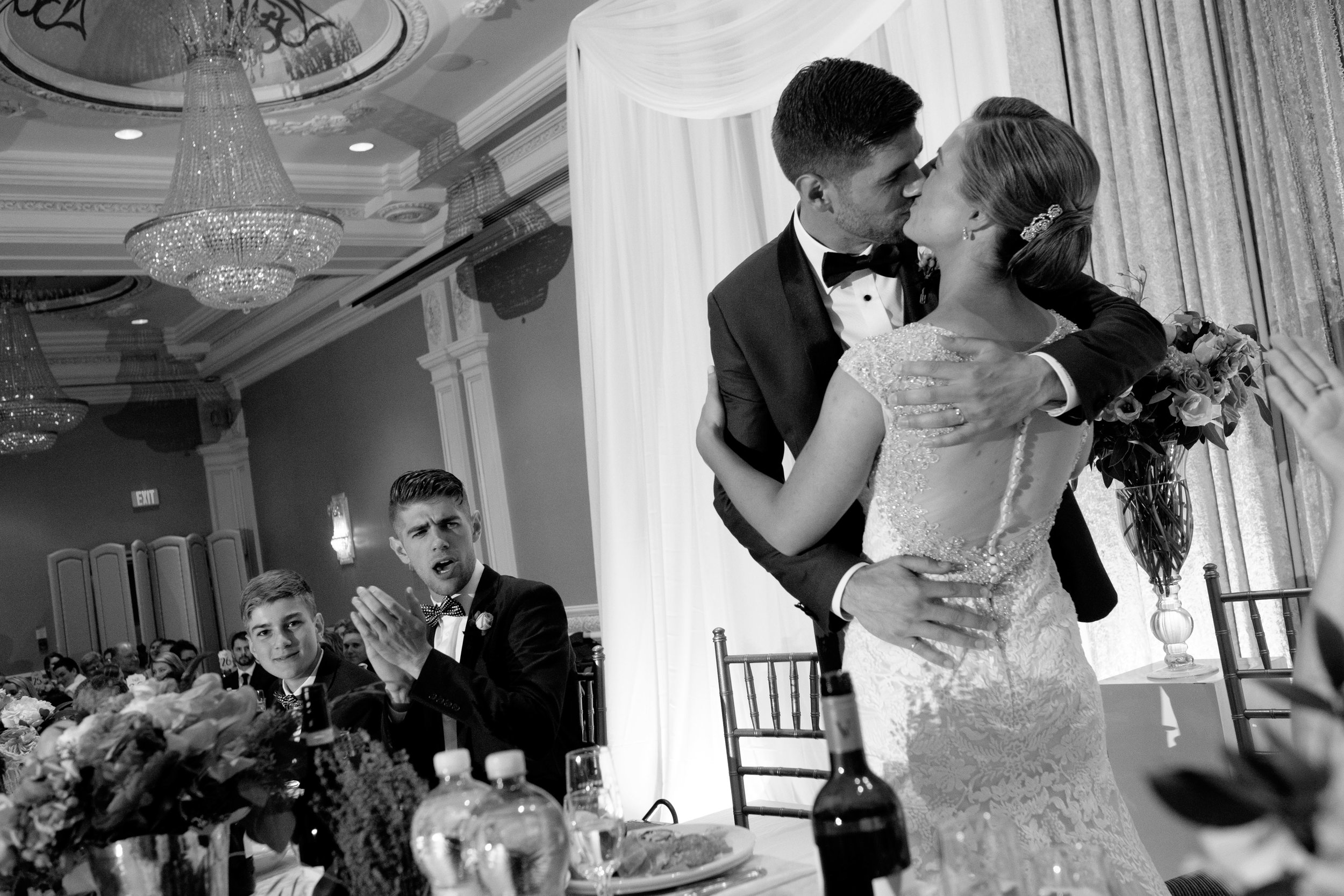 Sabrina and Zach share a kiss during their wedding reception at the Jewel Event Centre in Toronto.