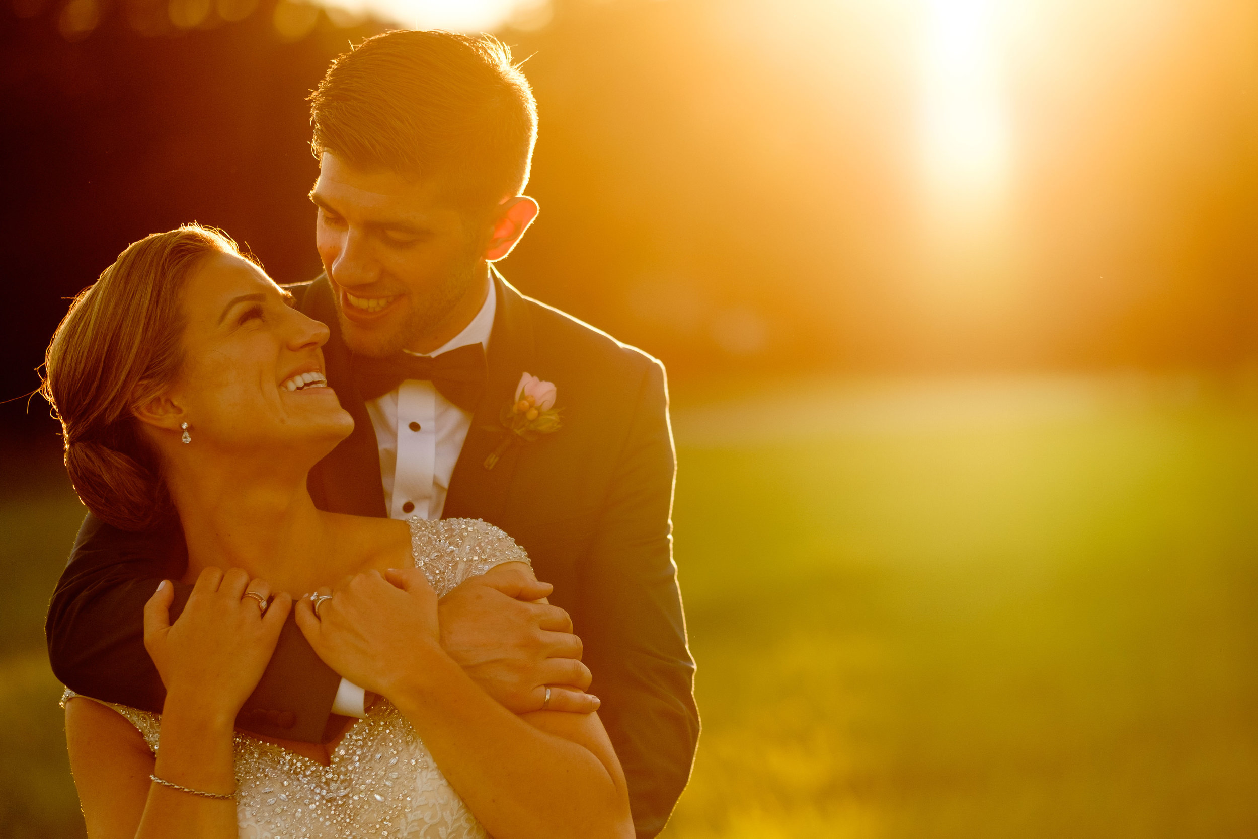 A wedding portrait of Sabrina + Zach at sunset during their wedding reception at the Jewel Event Centre.