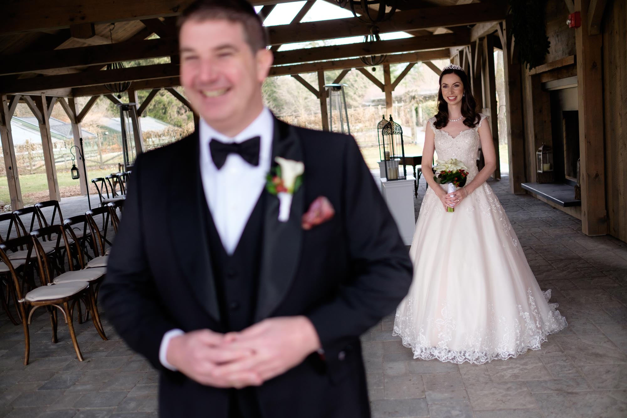 Rob waits patiently for his first look with his bride Amanda at Langdon Hall.
