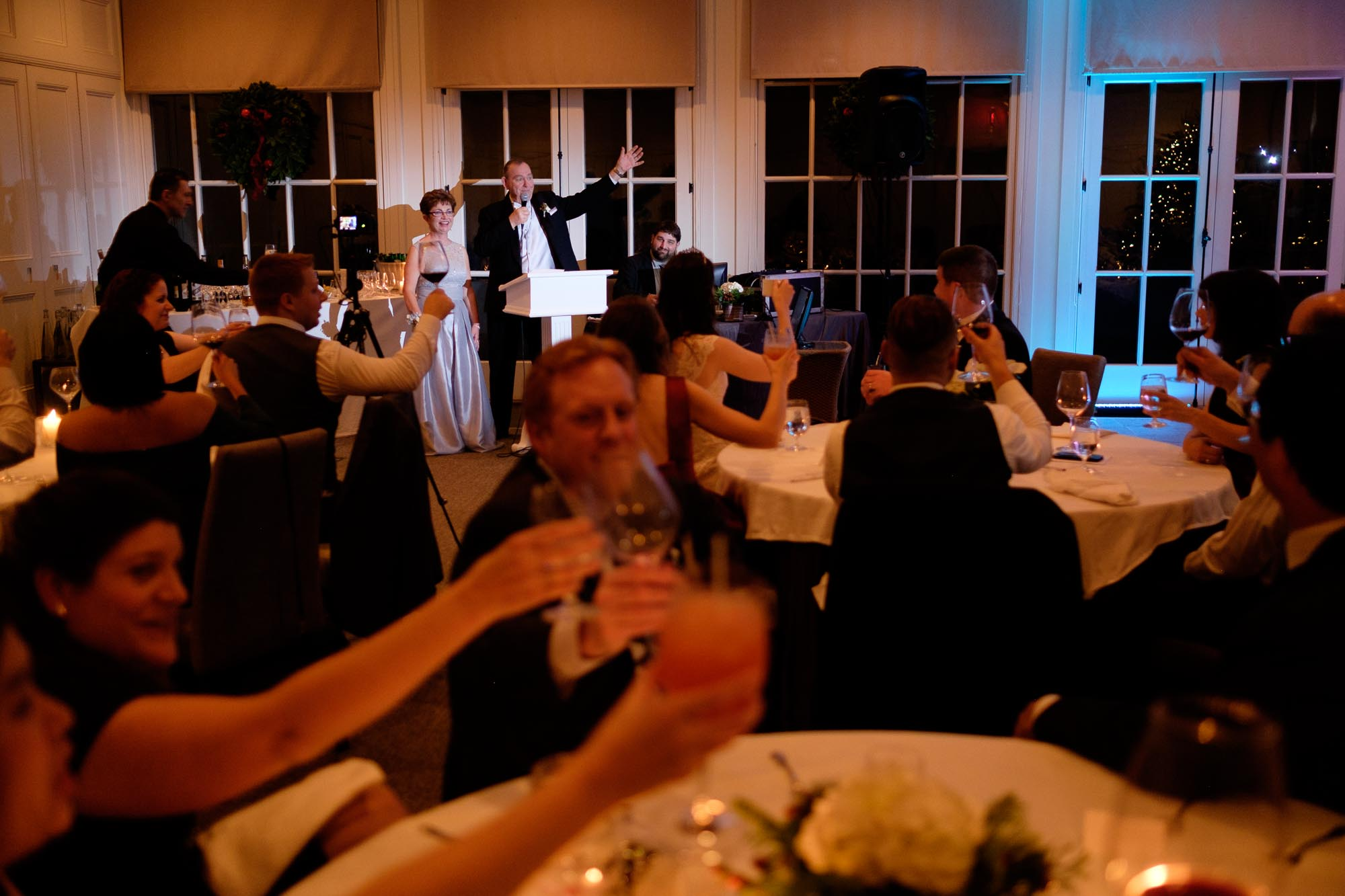 The bride's parents toast the newlywed couple during their wedding reception at Langdon Hall in Cambridge, Ontario.