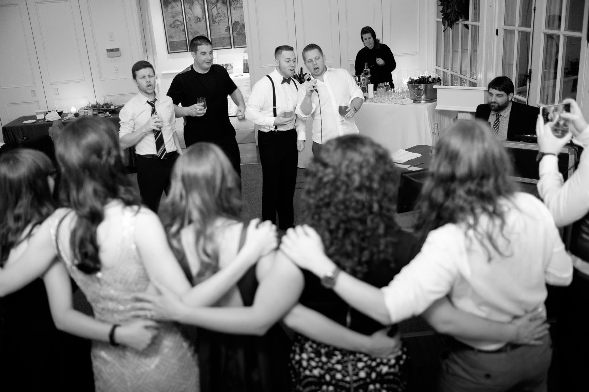 Everyone sings karaoke during Rob & Amanda's wedding reception at Langdon Hall.