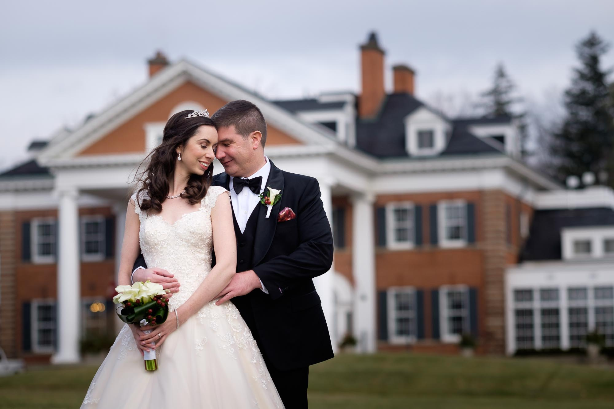 bride and groom pose for a wedding portrait outside of Langdon hall