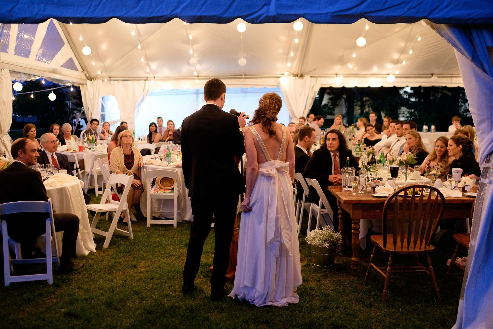 bride and groom give a wedding speech to their guests during their outdoor wedding reception at Markham Museum.