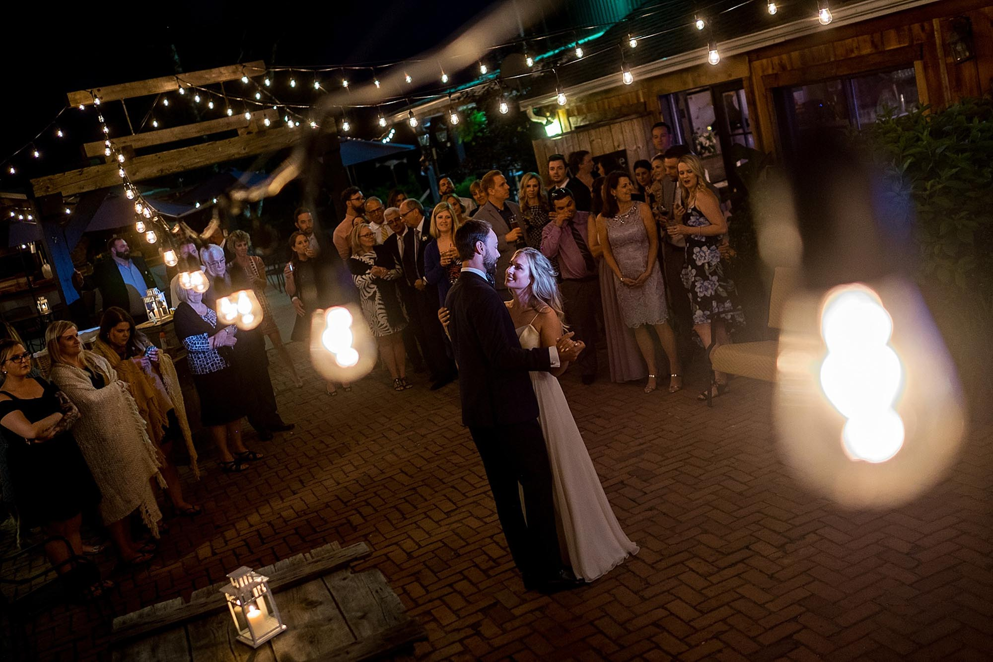 bride and groom enjoy their first dance outdoors as newlyweds during their reception at Hornburger Estate in Niagara on the Lake.