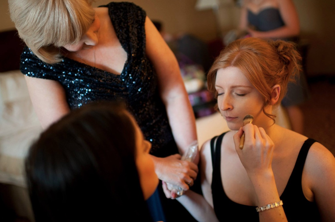 """""""One of my favourite pictures of me and my mama... Getting my makeup done the morning of my wedding, I started to feel that overwhelming mix of emotions that many brides do - nervous, excited, and so full of joy and love.  I remember reaching my hand out, and calling, """"Mama?"""" And like so many times before in my life, she reached back and said, """"I'm here."""" I love this picture because it captures perfectly how present, aware, and loving my mom always is.""""  Jacqueline + Shaun"""