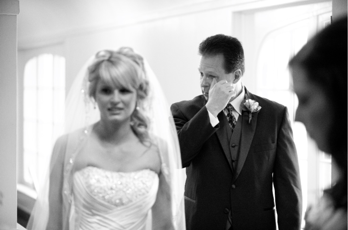 """When I first look at this picture it brought tears to my eyes.  I have always been """"daddy's little girl"""" and was surprised that my dad didn't shed a tear on the day (or so I thought).  Thanks to Scott a moment that I would have missed was captured.  When I look back on it in 20 years it will still show the true emotion that my dad felt that day and that I truly was and still am """"daddy's little girl"""".  Melissa + Jason"""