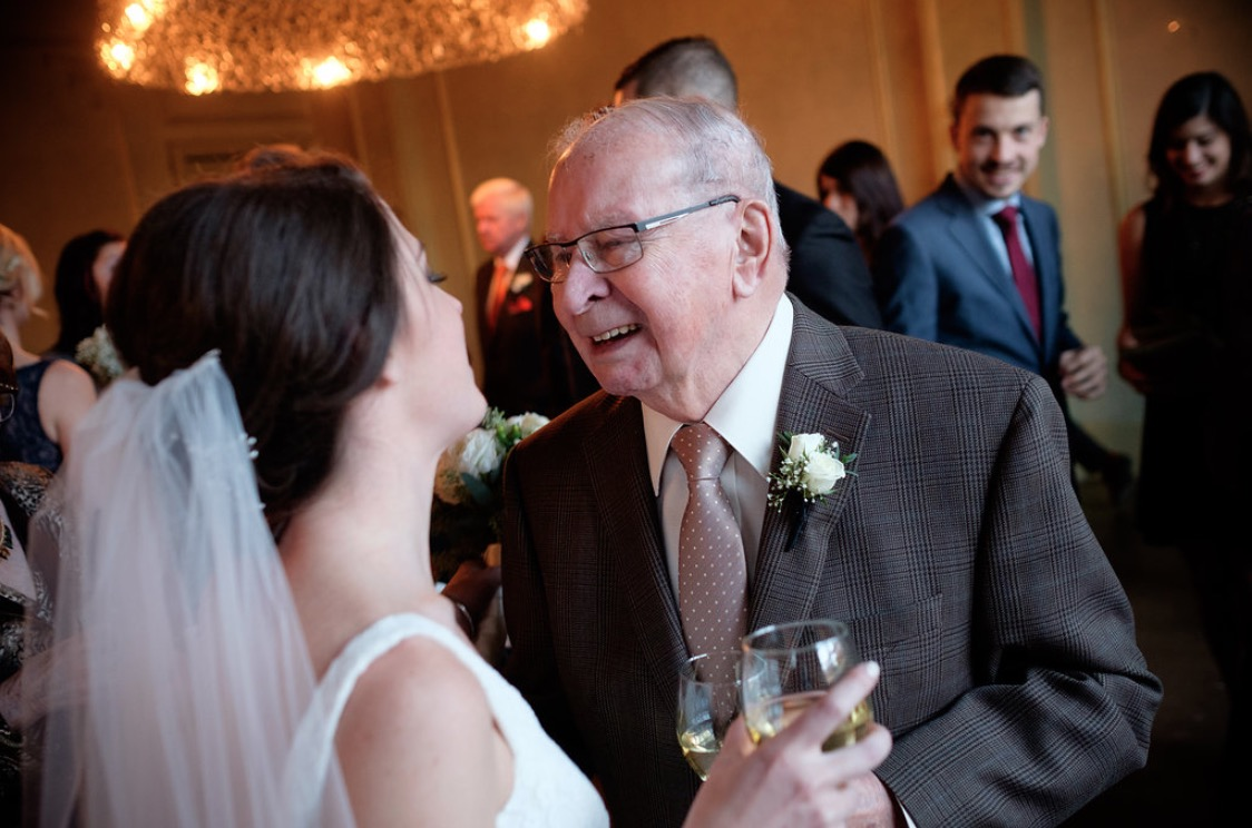 'My grand-papa and I always had a strong bond. I spent many summers when I was young in Chicoutimi with him and my grand-maman. It meant so much to me that he made the trip for our wedding in October, especially knowing he didn't like to leave the comfort of his home in recent years.    I still remember the emotion on his face from this moment, so happy and proud to see his eldest grand-daughter be married. I am so grateful Scott was there to capture it. What makes this picture even more special is that my grand-papa passed away almost 6 months to the day of our wedding. I will cherish this picture for the rest of my life and remember a man that brought so much joy and love to my life.'  Emilie + John