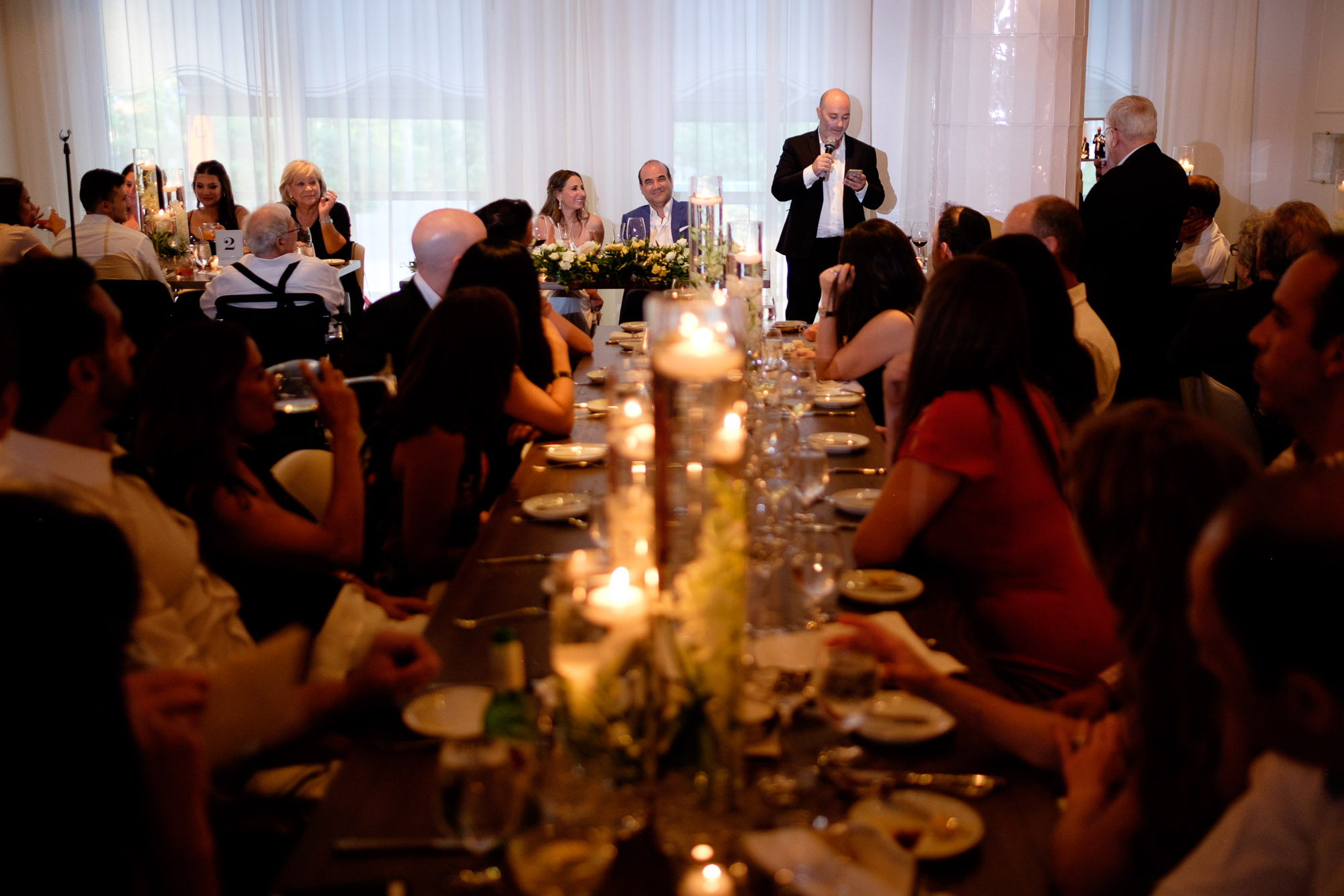 The bride and groom are toasted during their wedding reception at Sassafraz restaurant in Toronto's Yorkville neighbourhood.