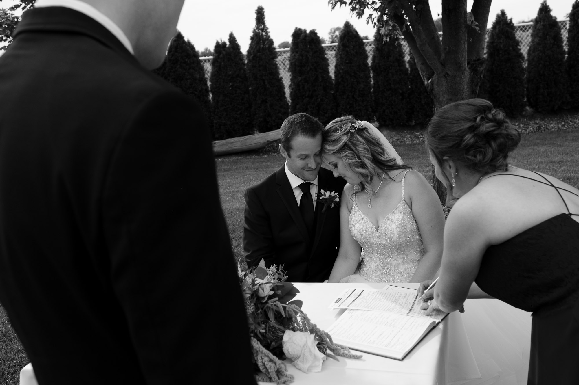 Alex and Colton share an intimate moment during the signing of the registry at the end of the wedding ceremony at the Hessenland Inn.