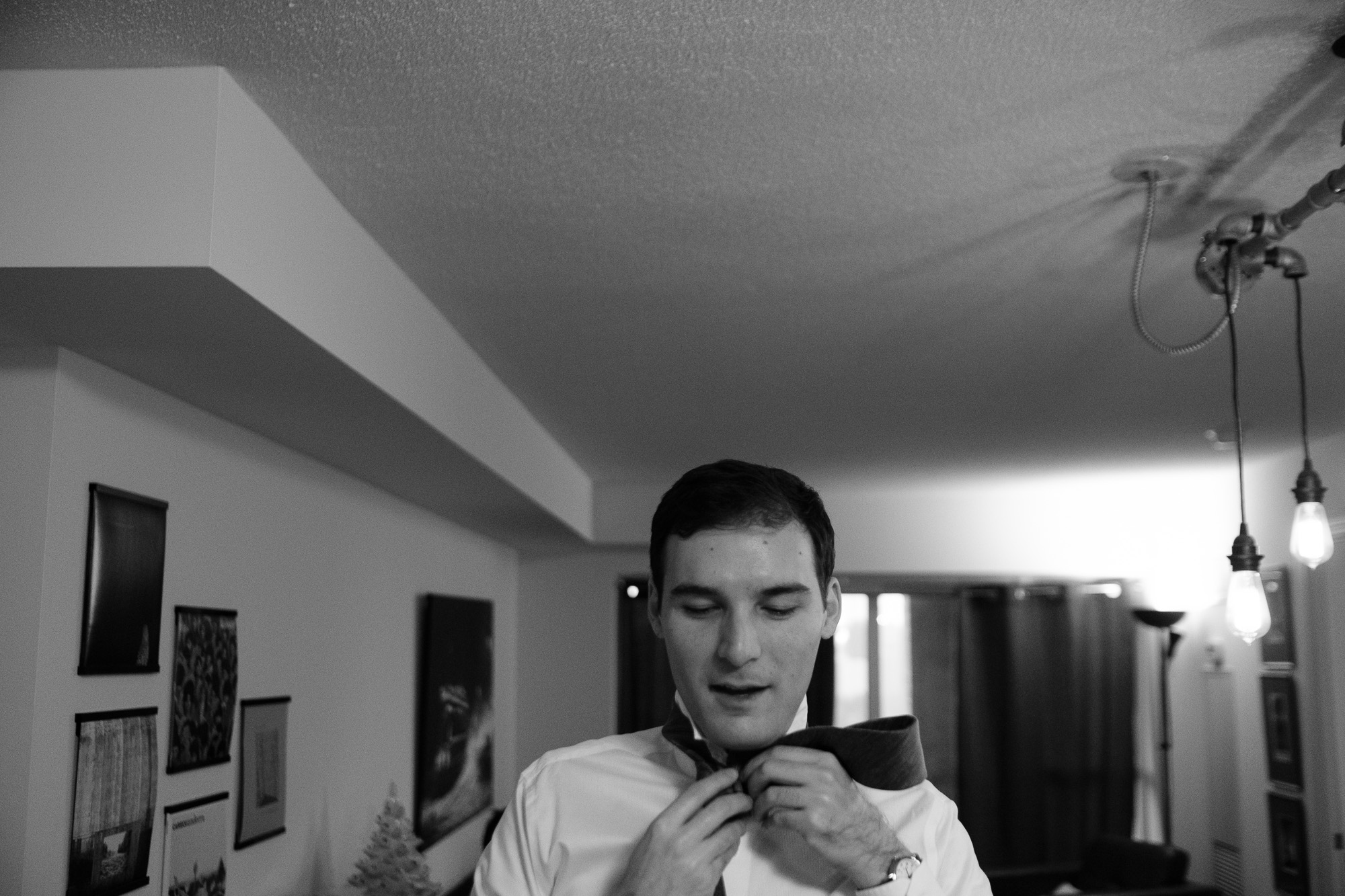 Rob gets ready at his best mans condo before his new years eve wedding at the Toronto Reference Library.