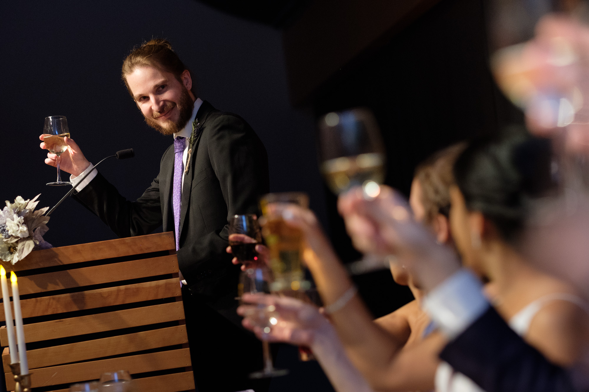 The best man gives a toast during the reception at Andrea + Rob's New years eve wedding at the Toronto reference Library.