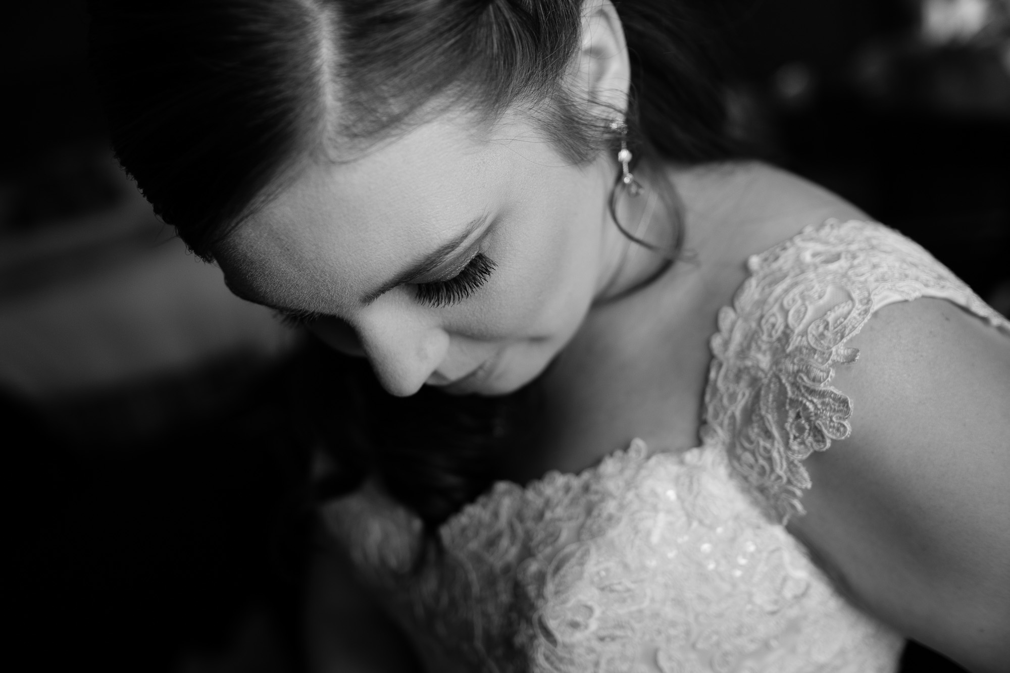 A casual portrait of the bride in her wedding dress as she gets ready for wedding ceremony at the Glenerin Inn just outside of Toronto.
