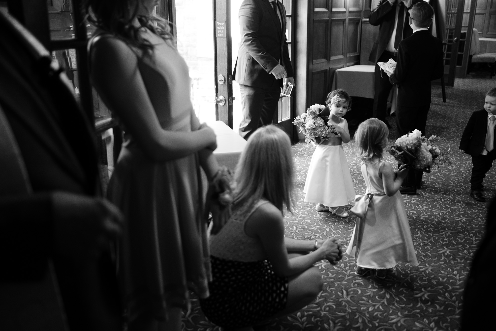 The flower girls wait in anticipation for their turn to lead the bride the down the aisle during the wedding ceremony at the Glenerin Inn outside of Toronto.