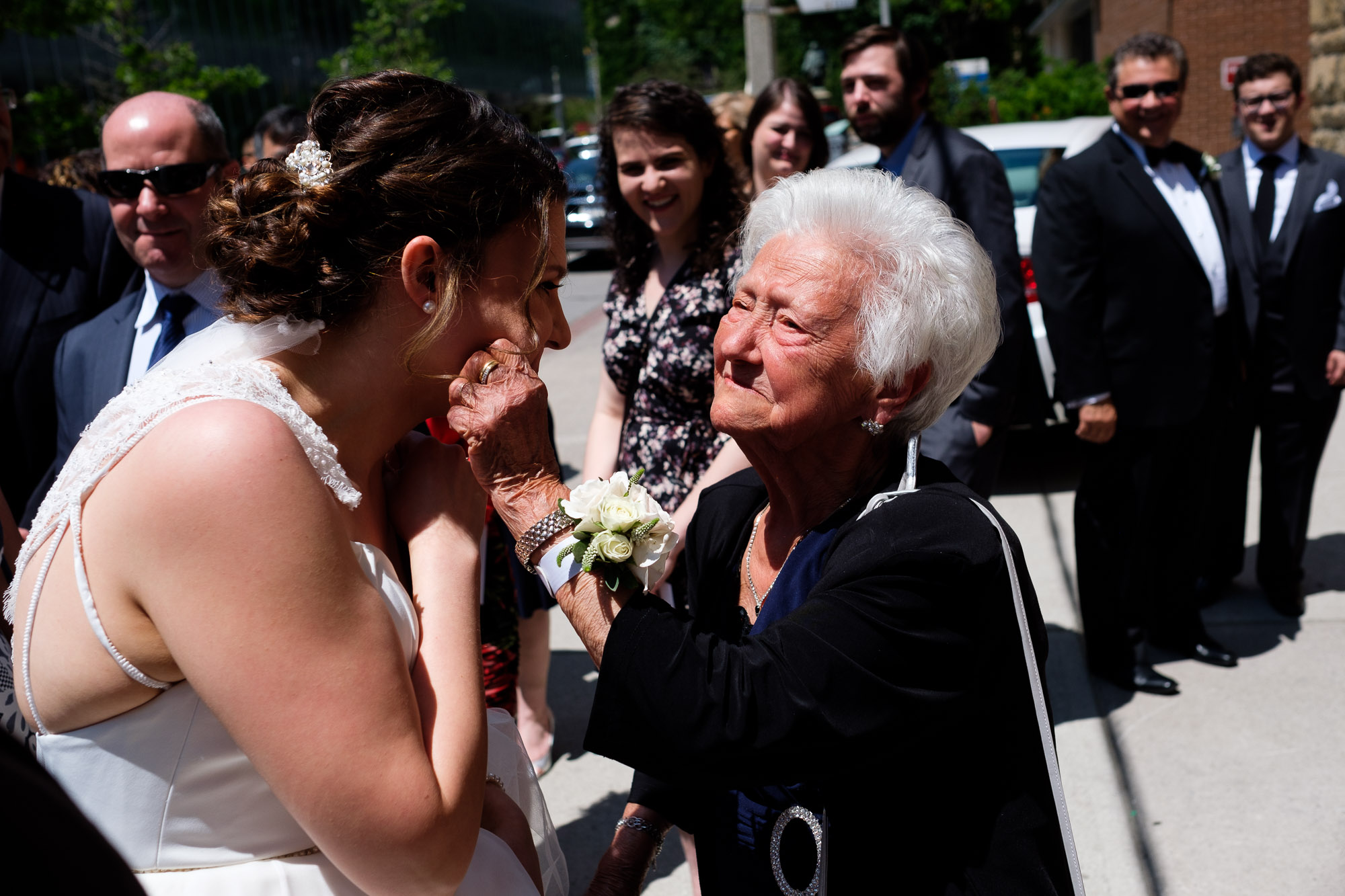 Katherine get's her cheeks pinched by her grandmother after the wedding ceremony at St. George's Greek Orthodox Church in Toronto.