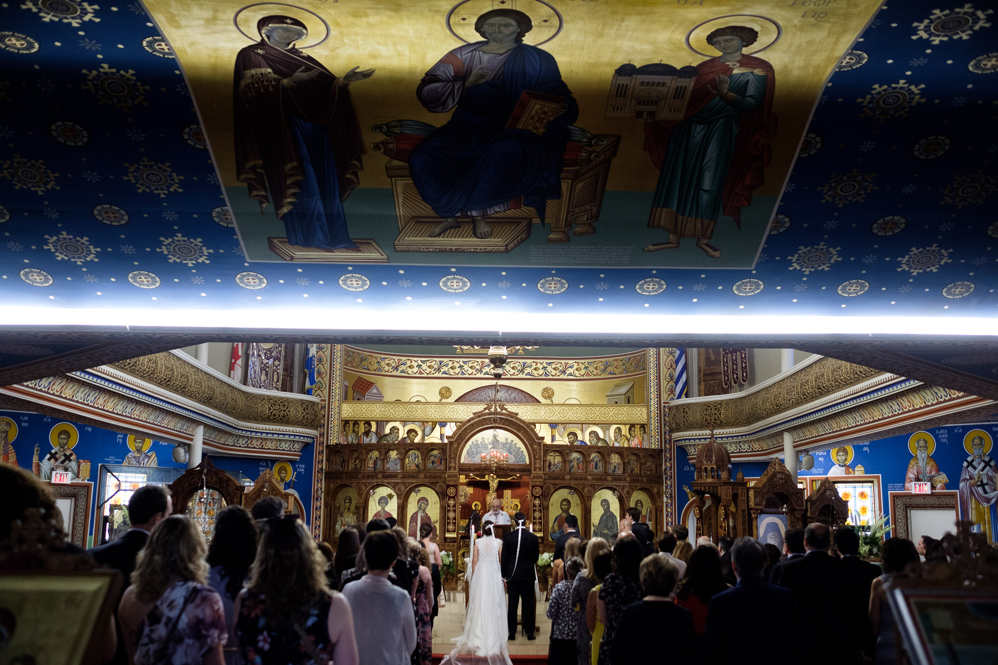 An overall wedding ceremony photograph from Katherine + Kosta's wedding ceremony at St. George's Greek Orthodox Church in Toronto.