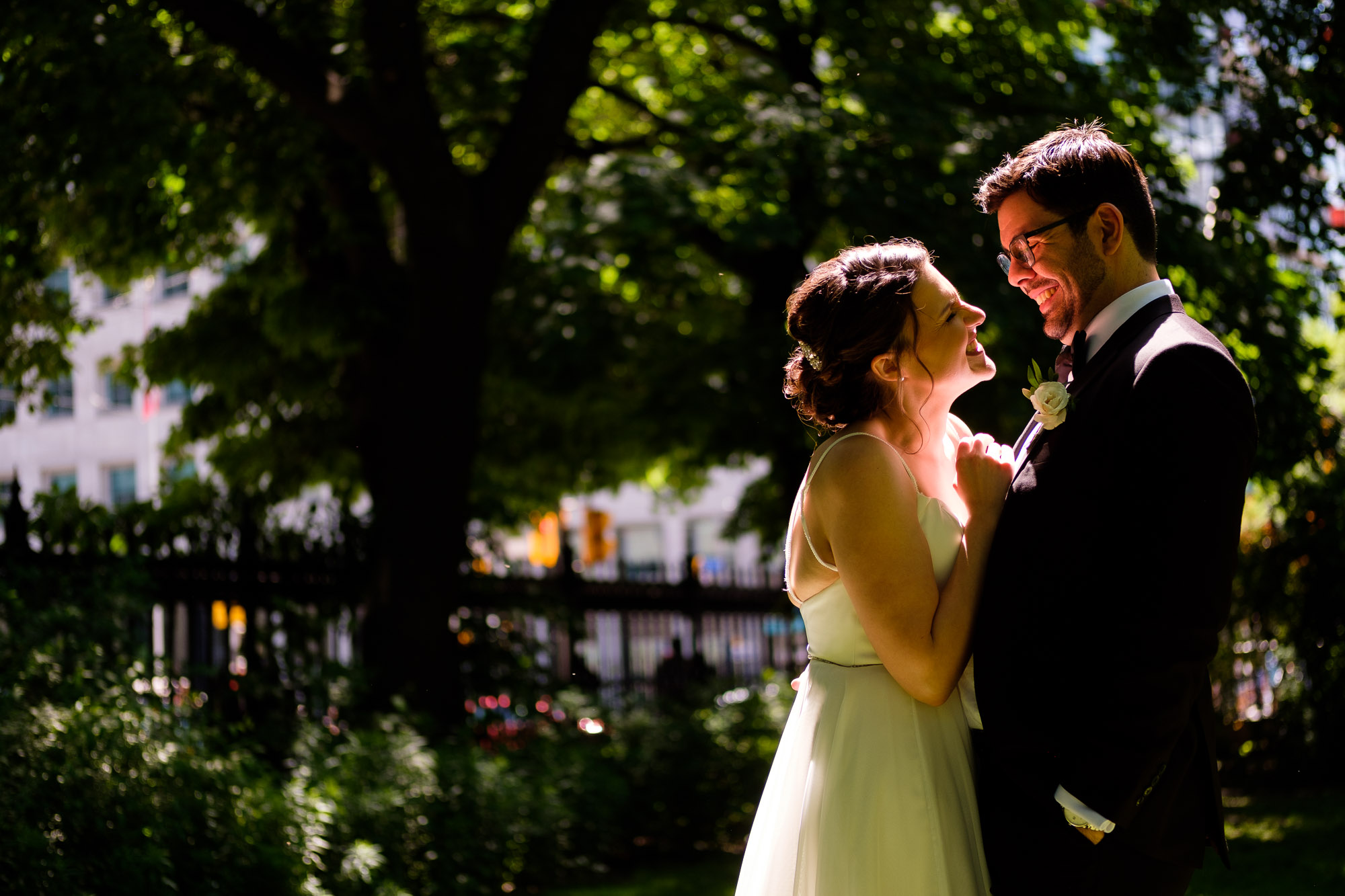 Katherine + Kosta share a laugh while having some wedding portraits taken near Osgoode Hall in Toronto before their wedding reception at Liberty Grand in Toronto.