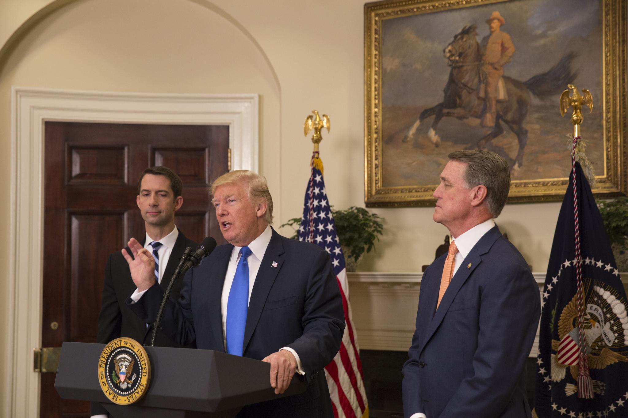 President_Donald_J._Trump,_Senator_Tom_Cotton,_and_Senator_David_Perdue,_August_2,_2017_(36182228582).jpg