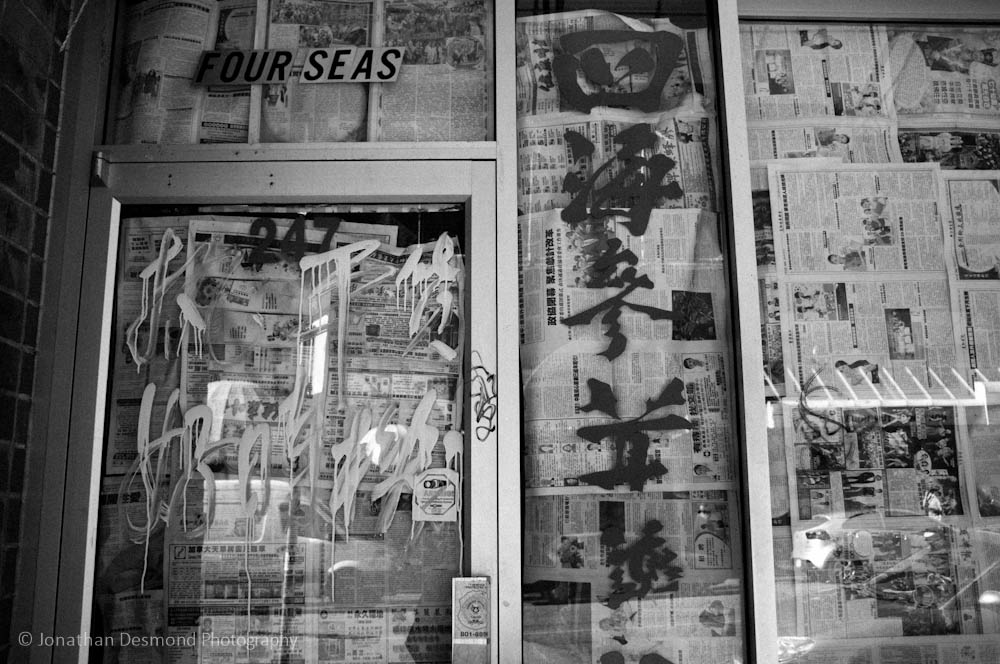 The imagery of the chinese writing against the newspaper blocking out the windows made for an interesting dissonance in this photograph. At least I think so.